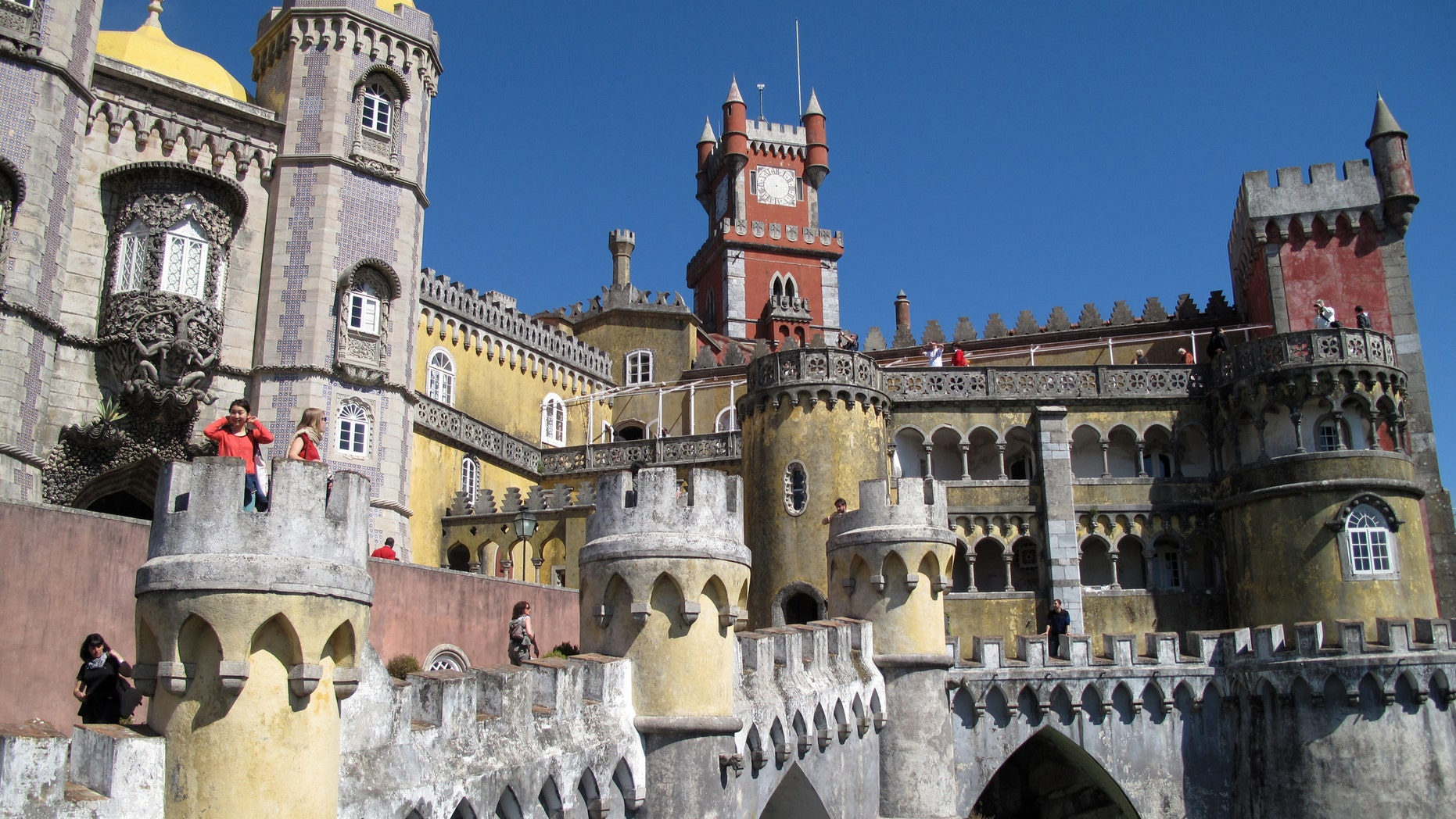 The exterior of Pena Palace in Sintra, Portugal. It's like a castle seen through a kaleidoscope, one of a number of spectacular buildings found in Sintra.