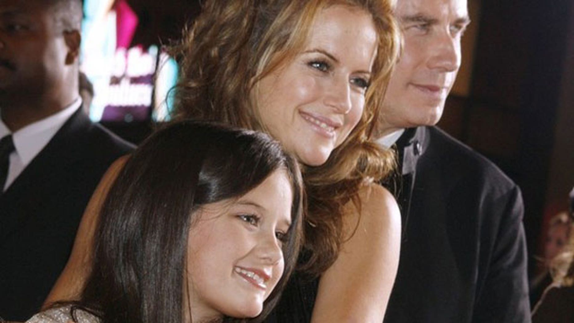 """Nov. 9: Actor John Travolta (R) and wife Kelly Preston pose with their daughter Ella Bleu Travolta (L) at the premiere of their new film """"Old Dogs"""" in Hollywood."""