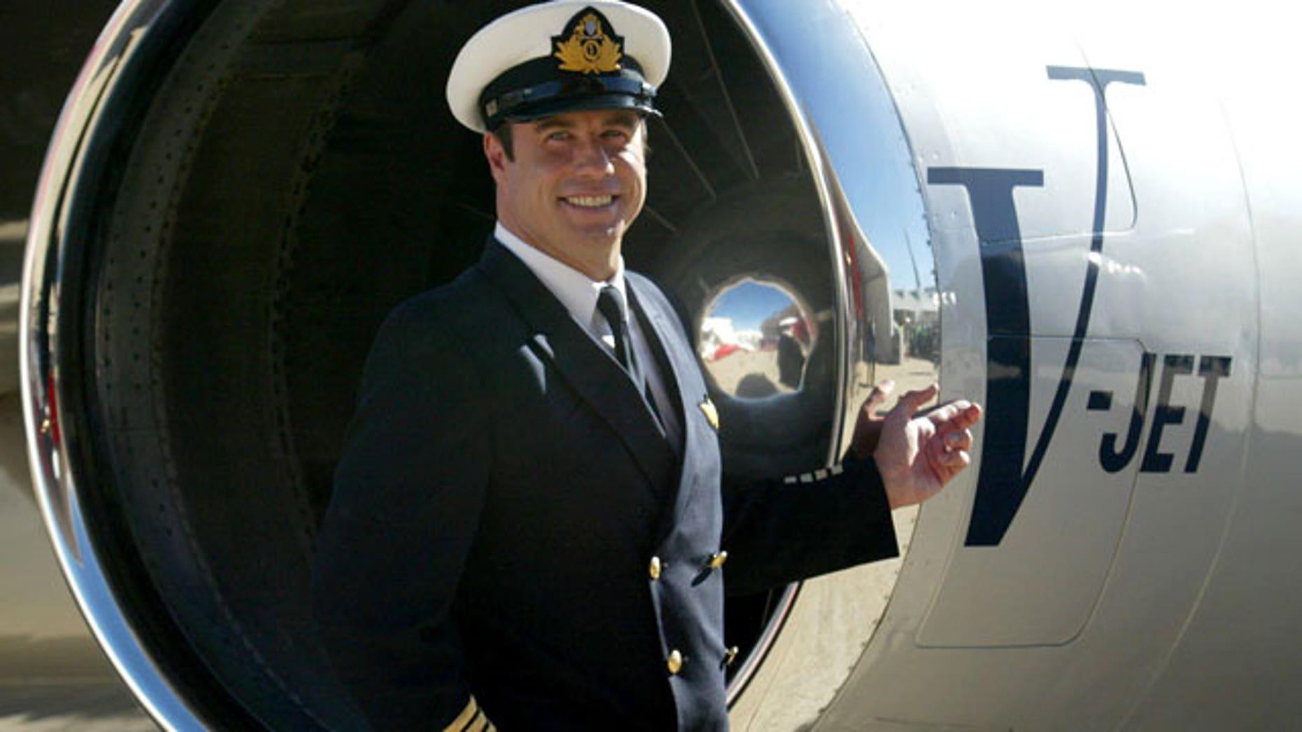 FILE: John Travolta, shown in front of his jet in 2002.
