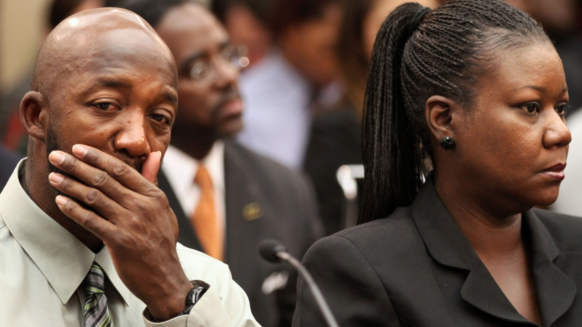 Trayvon Martin's parents, father, Tracy Martin, left, and mother Sybrina Fulton attend a House Judiciary Committee briefing on racial profiling and hate crimes, Tuesday, March 27, 2012, on Capitol Hill in Washington. (AP Photo/Jacquelyn Martin)