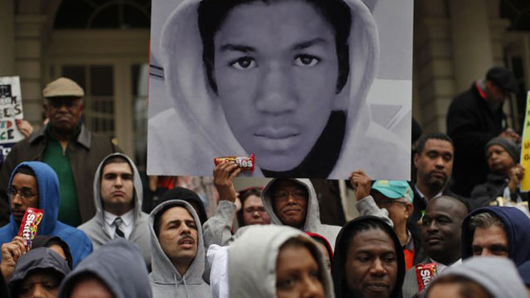 """March 28, 2012: Members of the New York City Council wear """"hoodie"""" sweatshirts as they stand together on the steps of City Hall in New York."""