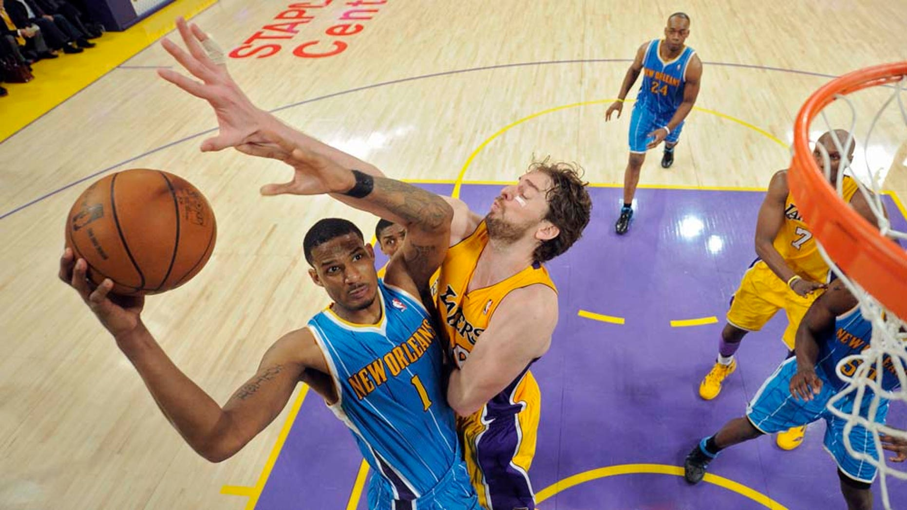 New Orleans Hornets forward Trevor Ariza, left, puts up a shot as Los Angeles Lakers forward Pau Gasol of Spain defends during the second half in Game 2 of a first-round NBA basketball playoff series, Wednesday, April 20, 2011, in Los Angeles. The Lakers won 87-78. (AP Photo/Mark J. Terrill)
