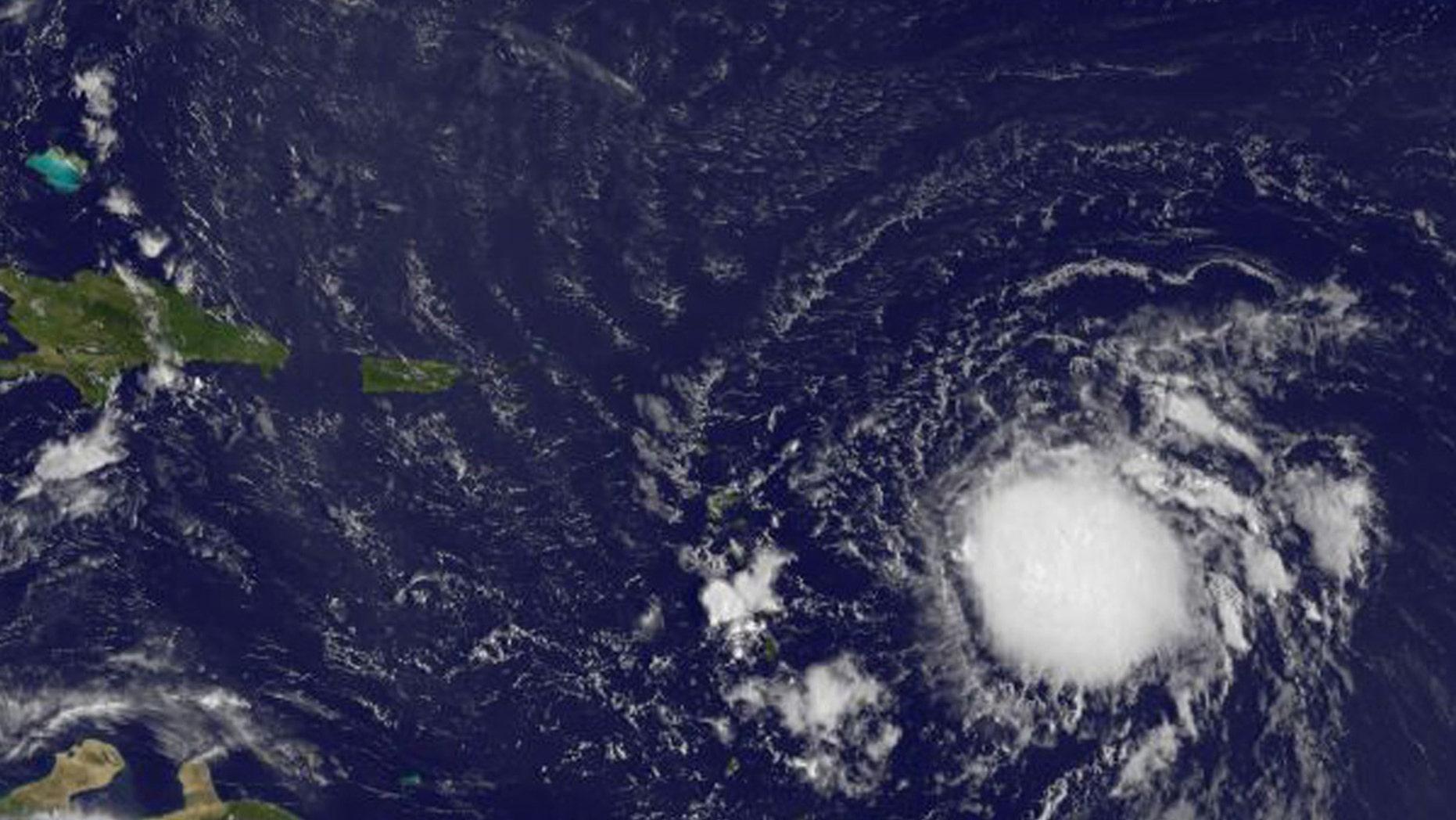 Tropical Storm Erika is pictured in the Atlantic Ocean northeast of Venezuela in this August 26, 2015 NASA handout satellite photo.