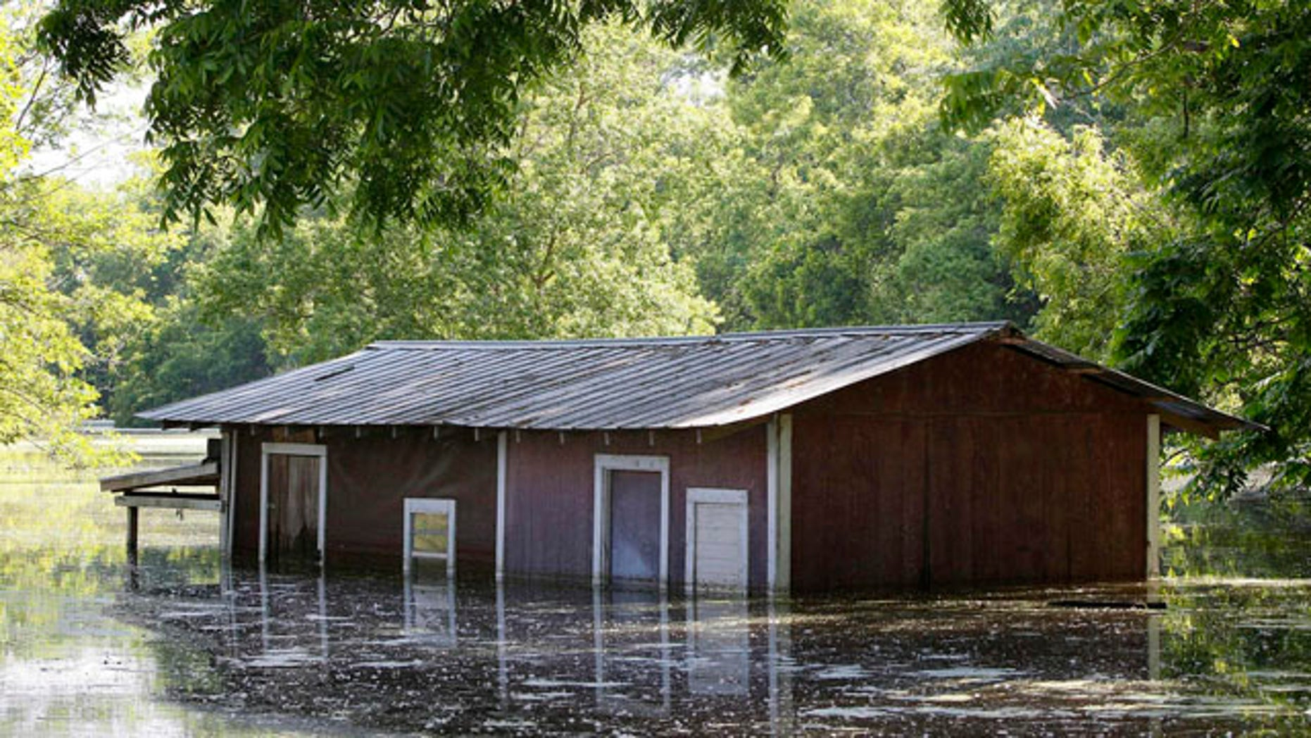 May 18, 2011: A partially-flooded building on the banks of the Atchafalaya River outside of the levee protection area in Simmesport, La.