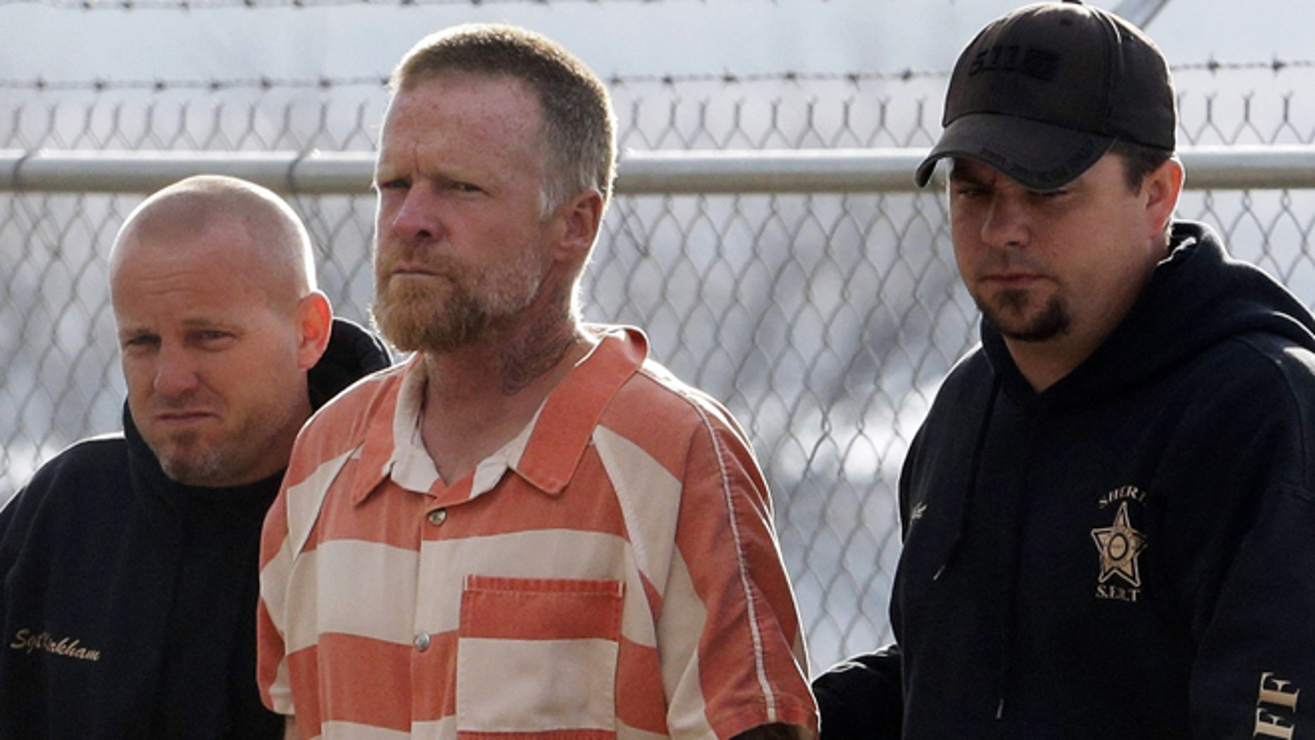 April 2, 2013: In this file photo, Troy James Knapp, 45, is escorted by Sanpete Sheriff's deputies to the Sanpete County Jail in Manti, Utah.