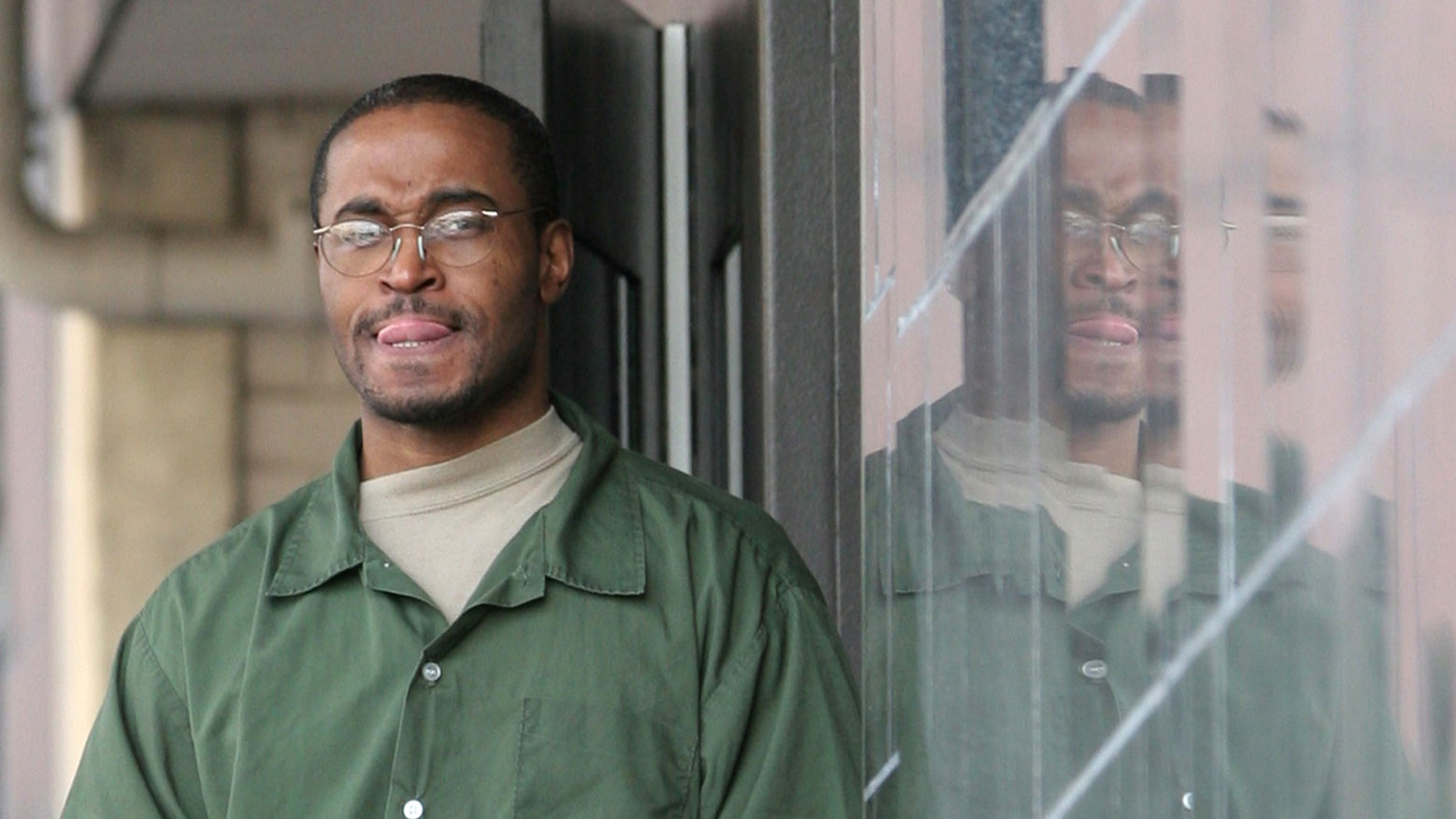 FILE - In this March 21, 2005, file photo  truck driver Tyrone Williams leaves the federal courthouse in Houston in shackles. Williams was resentenced to nearly 34 years in prison on Monday, Jan. 24, 2011, after a federal appeals court last year overturned the multiple life sentences he received for his role in America's deadliest human smuggling attempt, which resulted in the deaths of 19 illegal immigrants in 2003. (AP Photo/Pat Sullivan)