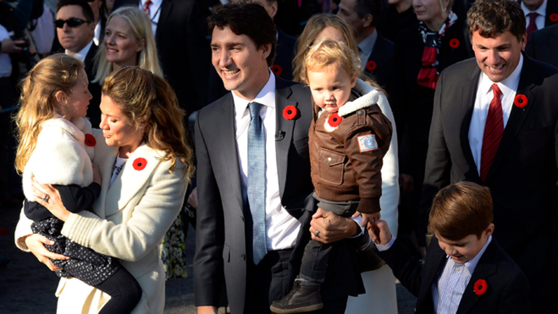 Nov. 4, 2015: Prime Minister-designate Justin Trudeau, his wife Sophie Gregoire-Trudeau and their children Ella-Grace, Hadrien and Xavier lead the new Liberal cabinet to Rideau Hall in Ottawa.
