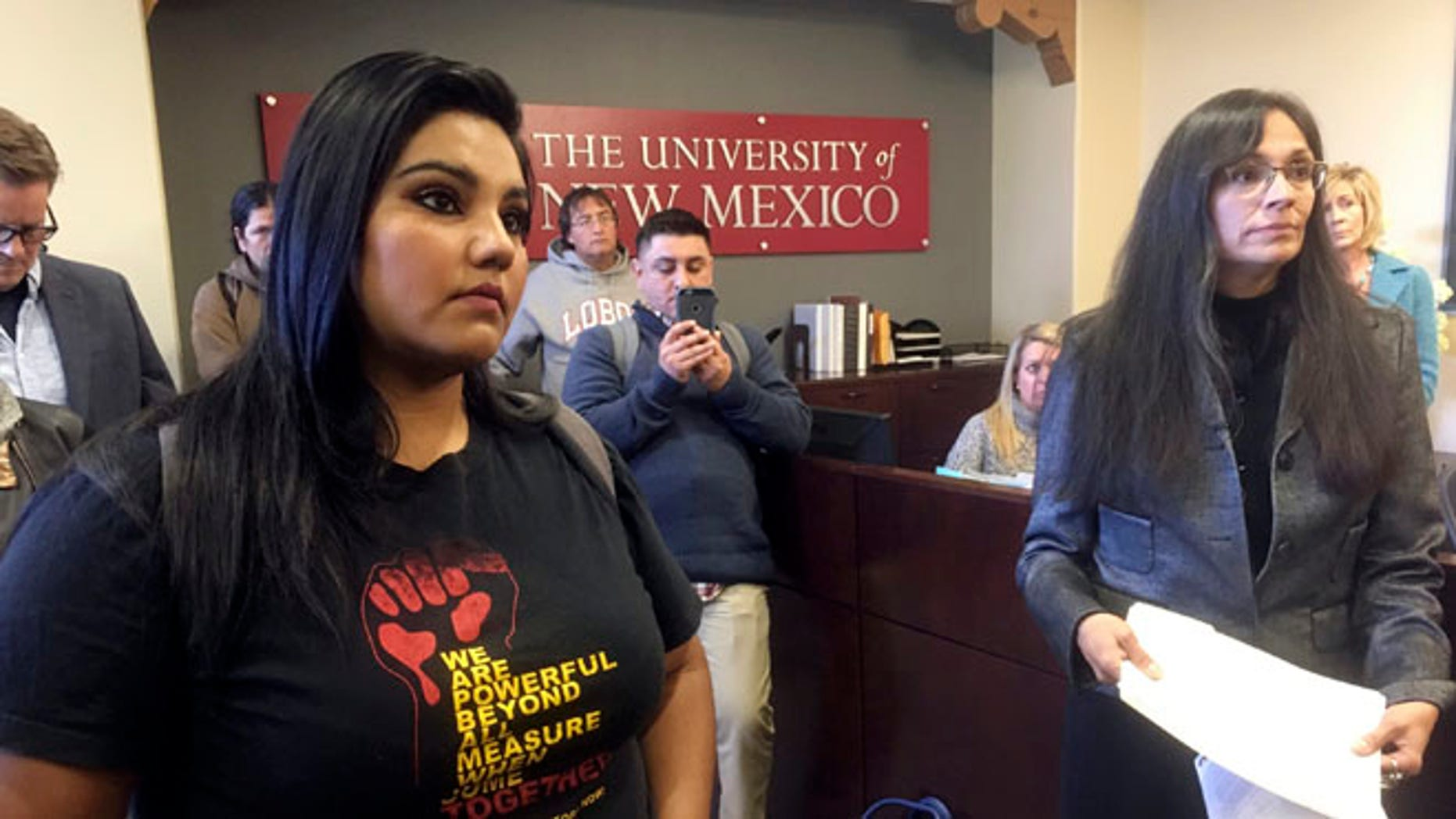 "University of New Mexico student LuzHilda Campos, left, and Chicano studies professor Irene Vasquez, right, present a letter with hundreds of signatures on Friday, Nov. 18, 2016, to school president Bob Frank asking him to declare the campus a ""sanctuary university,"" in Albuquerque, N.M. A group of professors at the largest university in the nation's most Hispanic state are asking for more protection of immigrant students following the election of Republican Donald Trump. (AP Photo/Russell Contreras)"