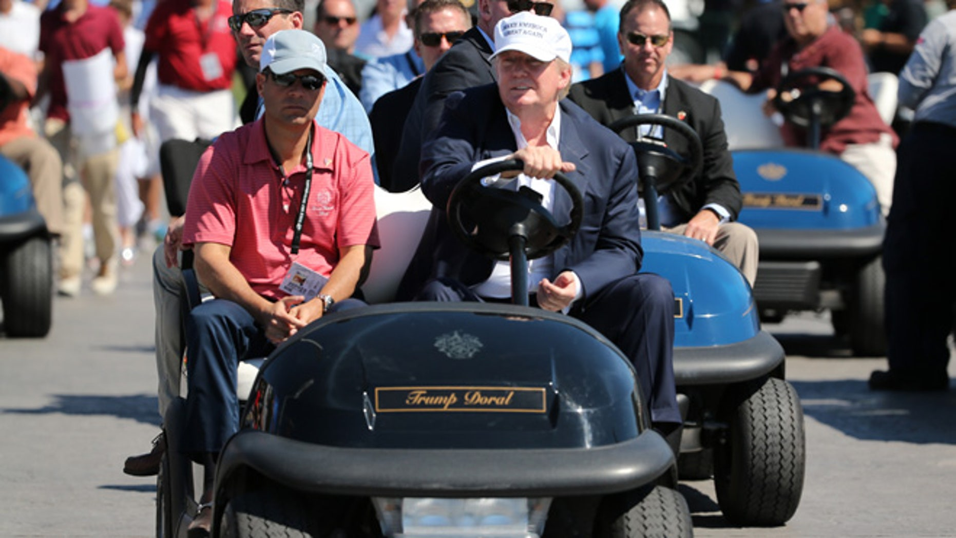 Republican presidential candidate Donald Trump makes an appearance prior to the start of play during the final round of the World Golf Championships-Cadillac Championship at Trump National Doral Blue Monster Course  on March 6, 2016 in Doral, Florida.  (Photo by Mike Ehrmann/Getty Images)