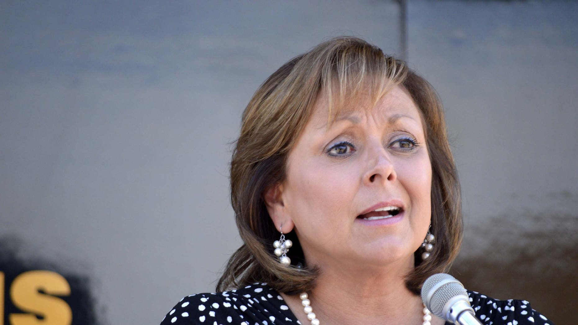 New Mexico Gov. Susana Martinez speaks about new laws expanding the state's Amber Alert and fighting child prostitution Wednesday, July 1, 2015, at a New Mexico Police State station in Albuquerque N.M. The nation's only Latina governor denounced fellow Republican and GOP presidential hopeful Donald Trump for his comments about Mexican immigrants. (AP Photo/Russell Contreras)