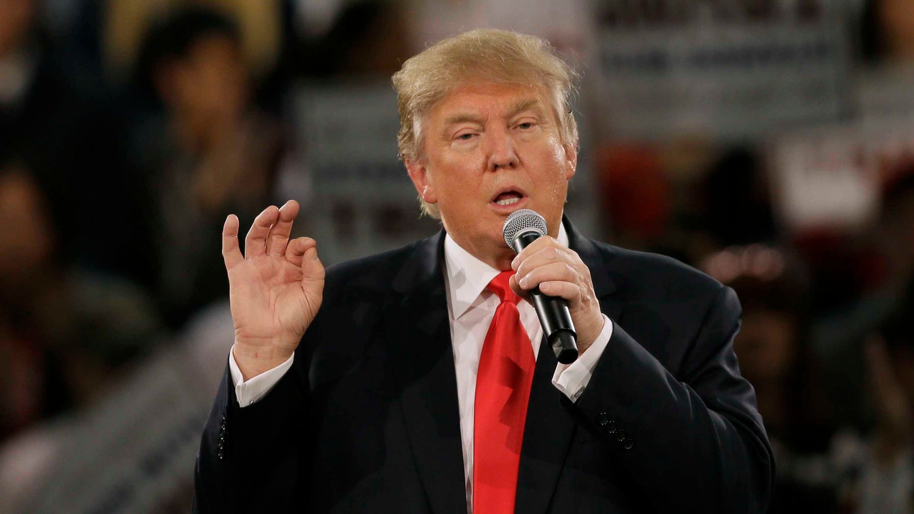 In this Dec. 11, 2015, photo, Republican presidential candidate Donald Trump speaks during a campaign rally in Des Moines, Iowa. Thereâs no legal or historical precedent for closing U.S. borders to the worldâs 1.6 billion Muslims, but neither is there any Supreme Court case that clearly prevents a president or Congress from doing so. Legal experts are divided over how the high court would react to Trumpâs call for a temporary halt to Muslims entering the United States. (AP Photo/Charlie Neibergall)