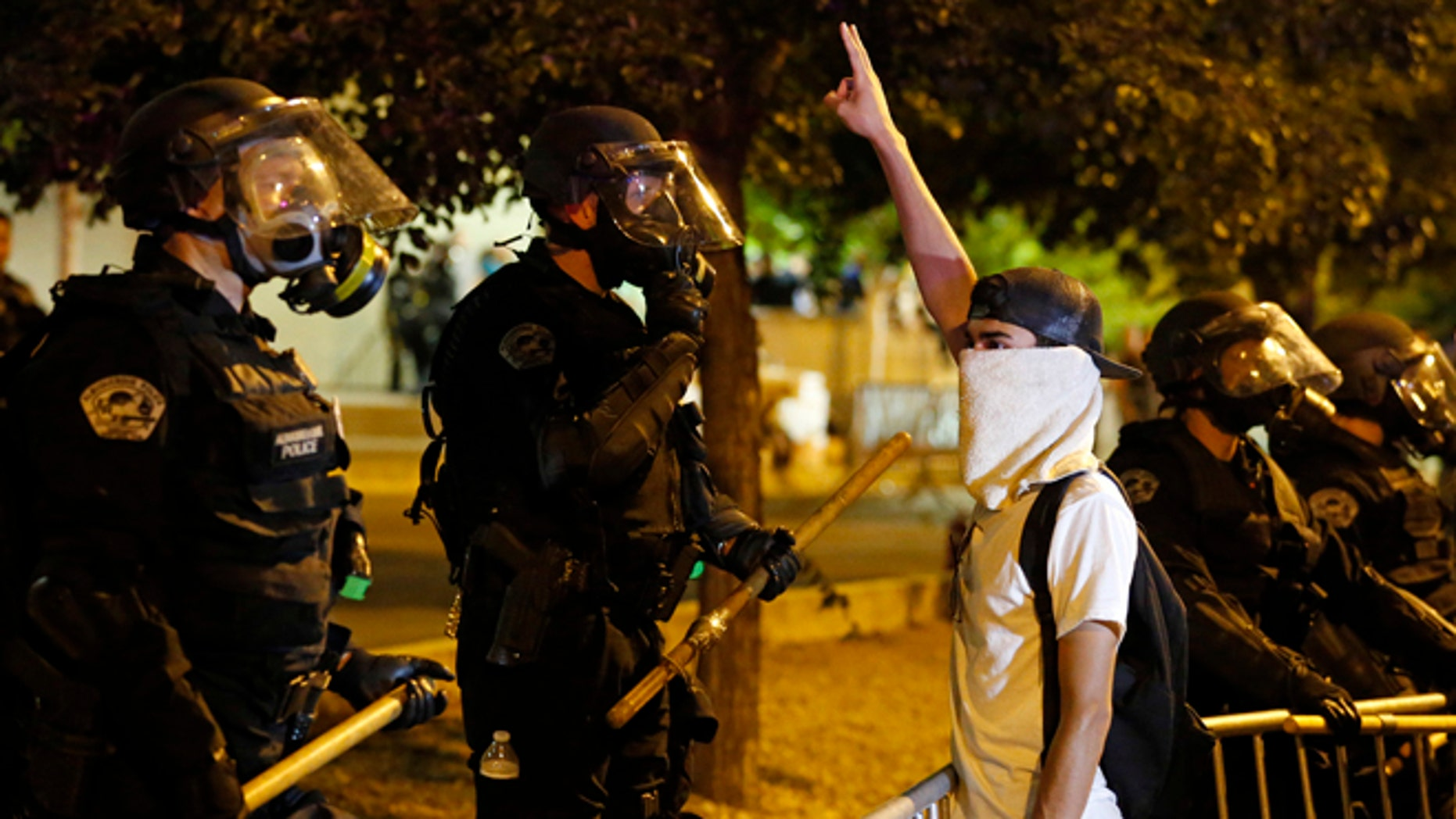 Riot police block off the Albuquerque Convention Center to anti-Trump protests Tuesday, May 24, 2016.