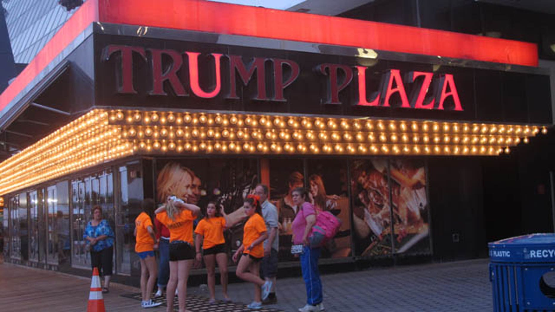FILE - In this July 24, 2014 file photo, several lights are burned out in the illuminated facade of Trump Plaza Hotel Casino in Atlantic City N.J. (AP Photo/Wayne Parry, FILE)