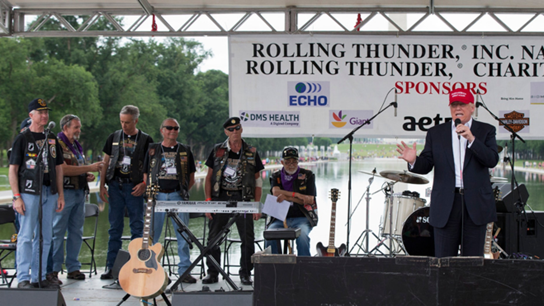 Republican presidential candidate Donald Trump, right, speaks to supporters and bikers at a Rolling Thunder rally at the National Mall in Washington, Sunday, May 29, 2016. (AP Photo/Manuel Balce Ceneta)