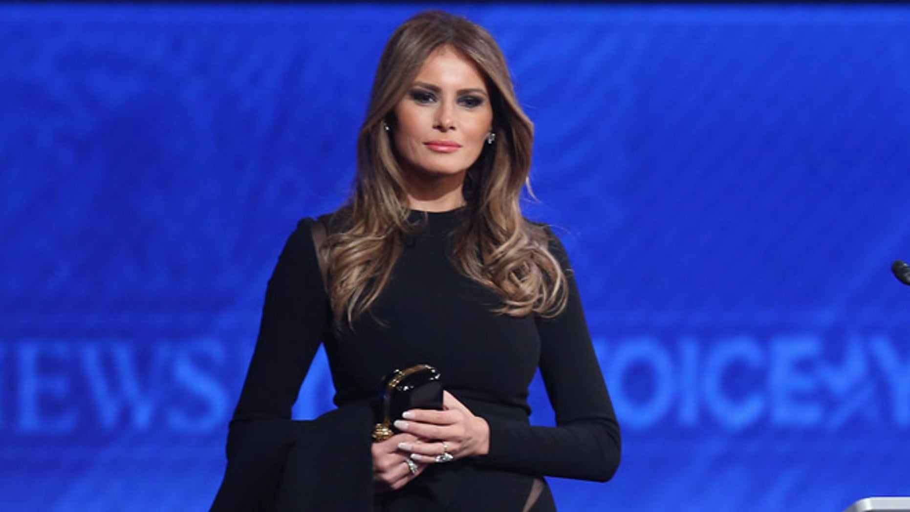 MANCHESTER, NH - FEBRUARY 06:  Melania Trump, wife of Republican presidential candidate Donald Trump, stands on stage following the Republican presidential debate at St. Anselm College February 6, 2016 in Manchester, New Hampshire. Sponsored by ABC News and the Independent Journal Review, this is the final televised debate before voters go to the polls for the New Hampshire primary on February 9.  (Photo by Joe Raedle/Getty Images)