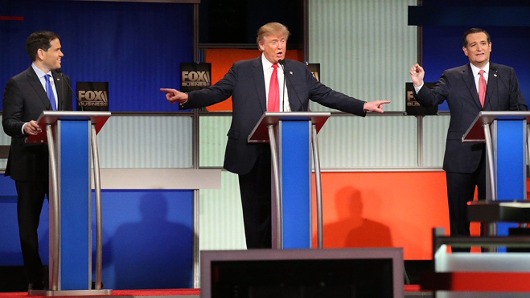 NORTH CHARLESTON, SC - JANUARY 14:  Republican presidential candidates (L-R) Sen. Marco Rubio (R-FL), Donald Trump and Sen. Ted Cruz (R-TX) participate in the Fox Business Network Republican presidential debate at the North Charleston Coliseum and Performing Arts Center on January 14, 2016 in North Charleston, South Carolina. The sixth Republican debate is held in two parts, one main debate for the top seven candidates, and another for three other candidates lower in the current polls.  (Photo by Scott Olson/Getty Images)