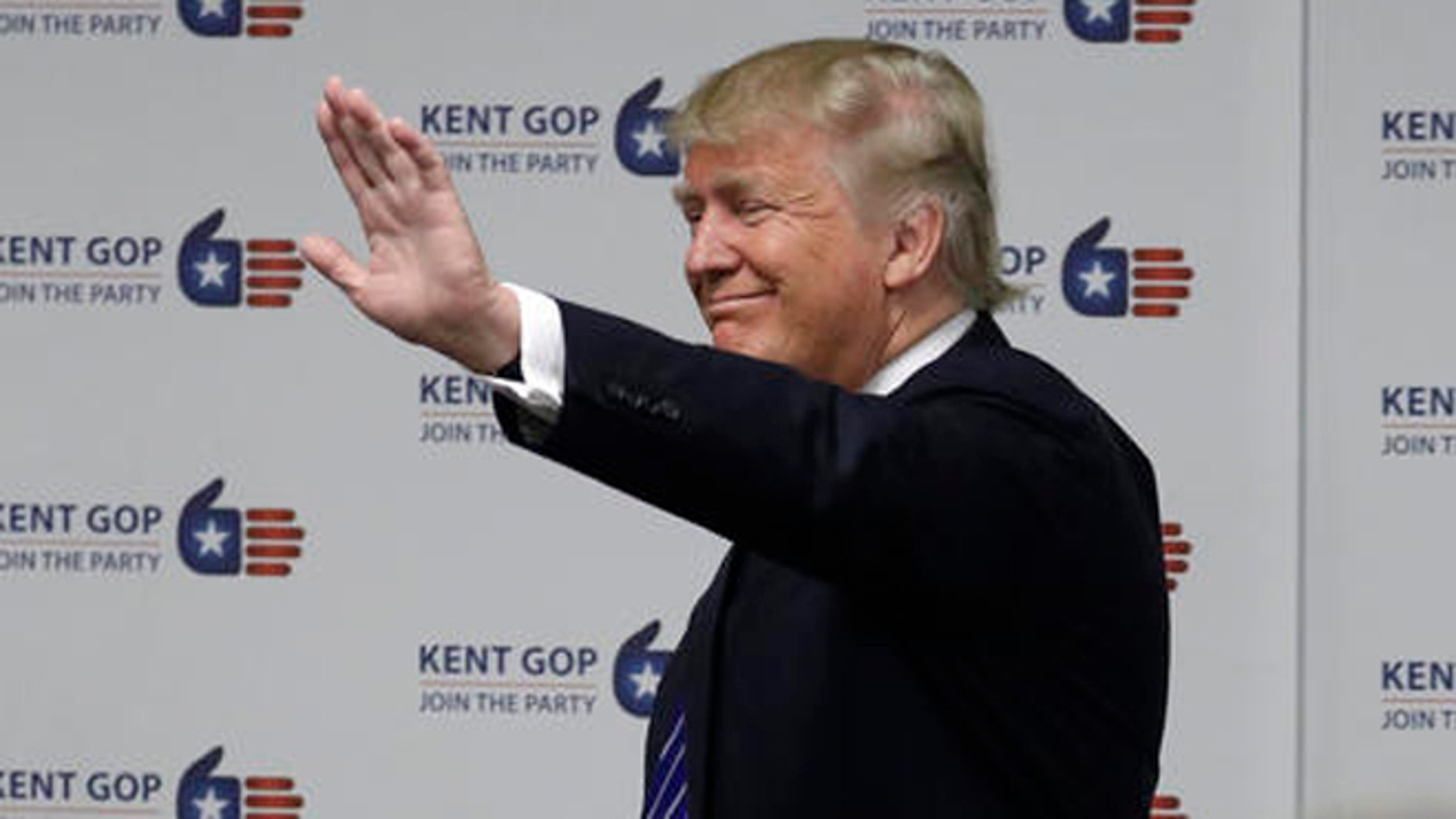 Republican presidential candidate Donald Trump visits the Kent County Republican Headquarters, Friday, Sept. 30, 2016, in Grand Rapids, Mich. (AP Photo/John Locher)
