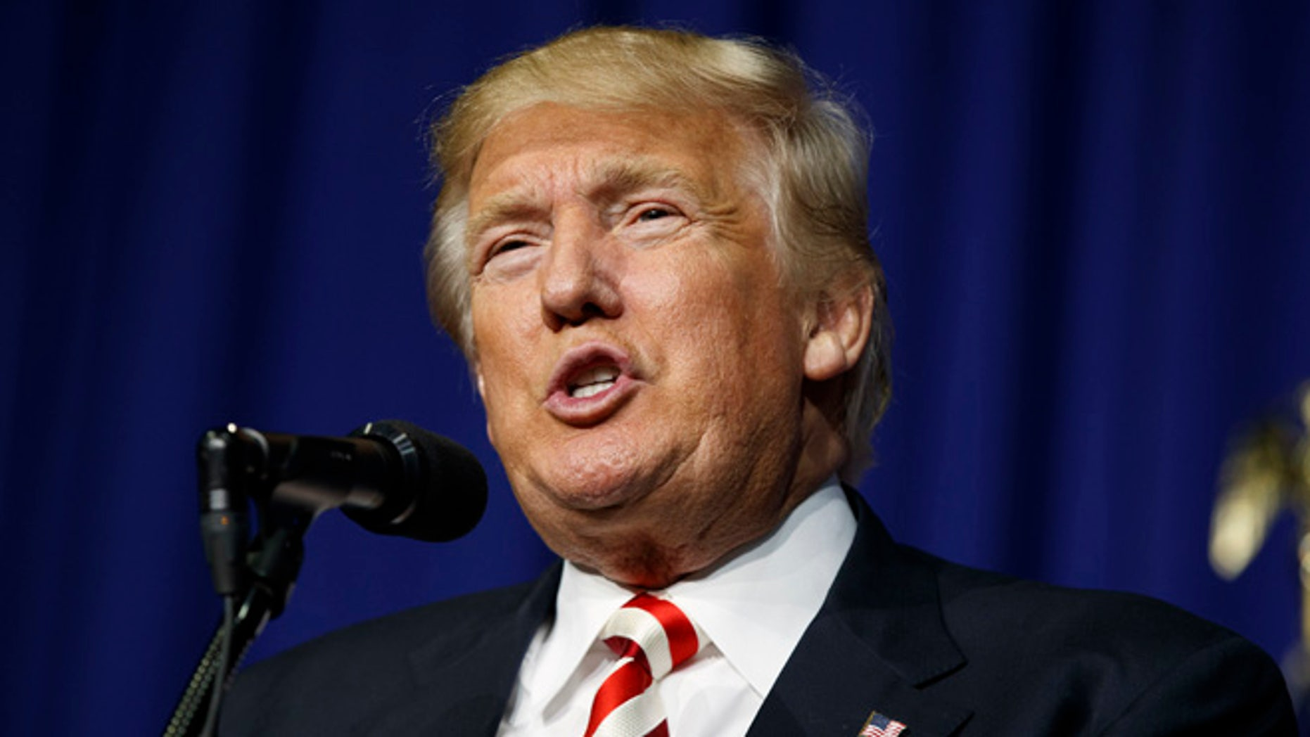 """FILE - In this Sept. 1, 2016 file photo, Republican presidential candidate Donald Trump speaks during a campaign rally in Wilmington, Ohio. The 2016 presidential election features two candidates with dramatically different approaches on immigration. In tone, Republican Donald Trump often highlights violent crimes perpetrated by immigrants in the country illegally with aggressive rhetoric that seizes on nationalism if not xenophobia. Democrat Hillary Clinton features a softer approach that embraces diversity and the value of keeping immigrant families together, even as her critics accuse her of promoting """"open borders."""" (AP Photo/Evan Vucci, File)"""