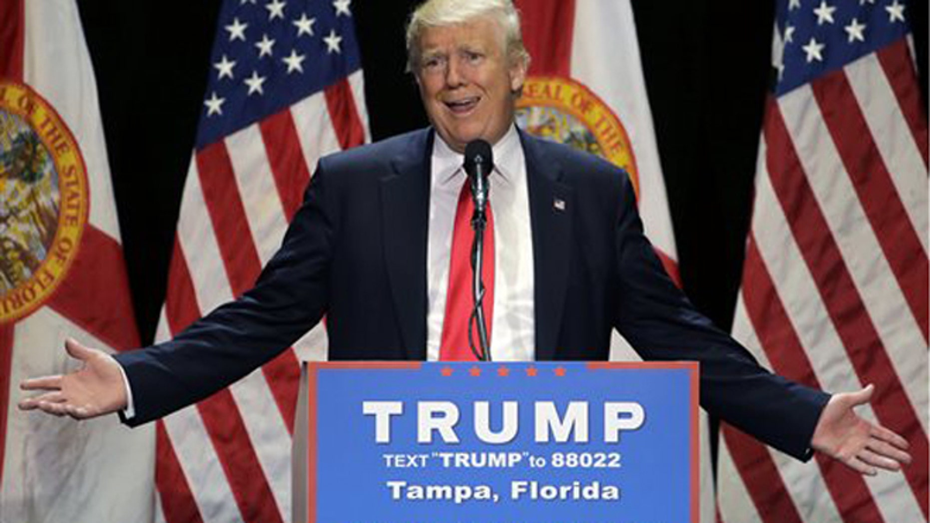 File- This June 11, 2016 file photo shows Republican presidential candidate Donald Trump gesturing during a campaign speech in Tampa, Fla. Trump plans Monday to further address the deadliest shooting in modern U.S. history in a campaign speech originally intended to attack the presumptive Democratic nominee, Hillary Clinton. The switch comes a day after Trump called for Clinton to drop out of the race for president if she didnt use the words radical Islam to describe the Florida nightclub massacre. (AP Photo/Chris O'Meara, File)