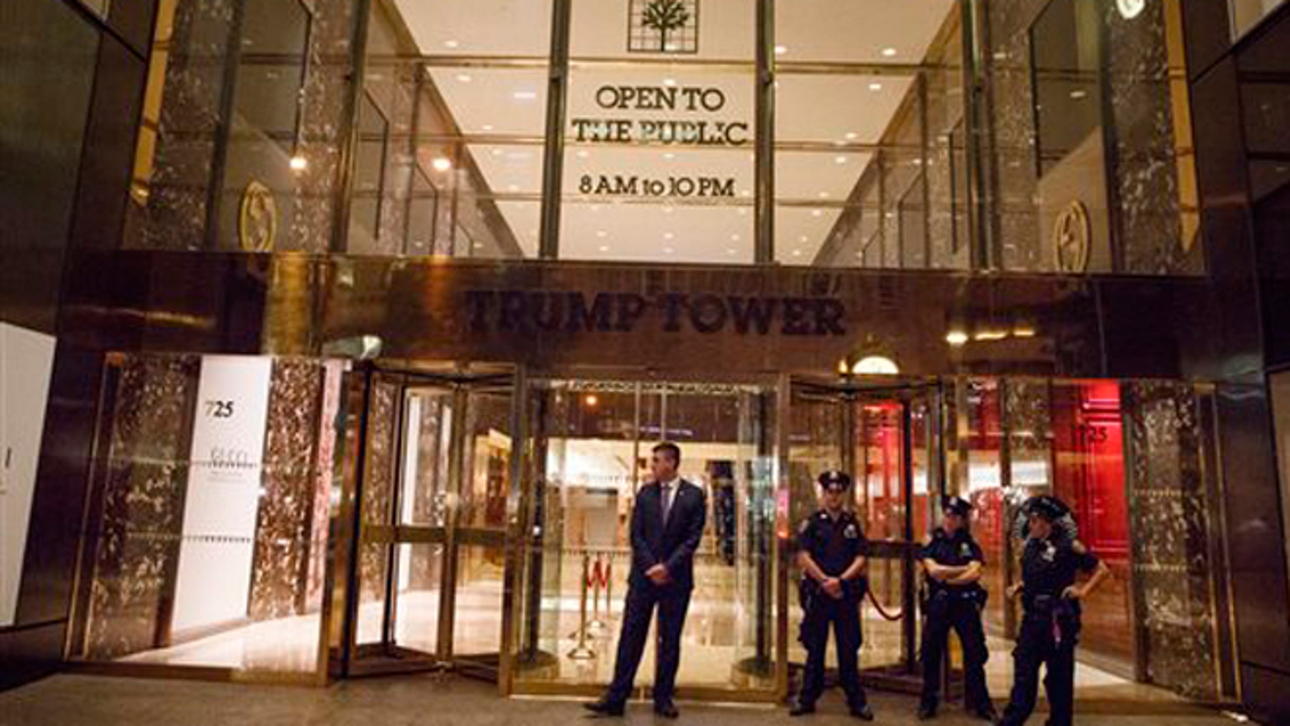 New York police and security stand outside Trump Tower on, Saturday, Oct. 8, 2016, in New York. Republican presidential candidate Donald Trump blurted out lewd and sexually charged comments about women as he waited to make a cameo appearance on a soap opera in 2005, a revelation that led him to issue a rare apology. (AP Photo/ Evan Vucci)