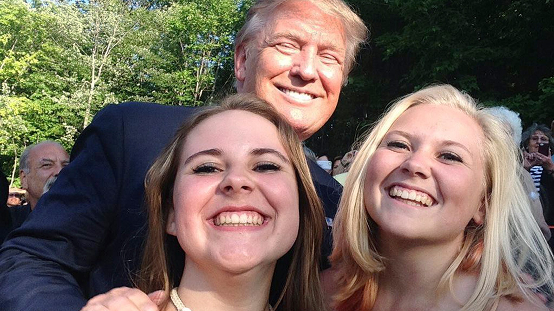 President Trump posed for a photo with Emma Nozell, left, and her sister Addy Nozell in Laconia, N.H. in July 2015. They snagged selfies with every candidate in the 2016 presidential campaign. Now, their mom, Wendy Thomas, is running her own campaign for state office in New Hampshire.