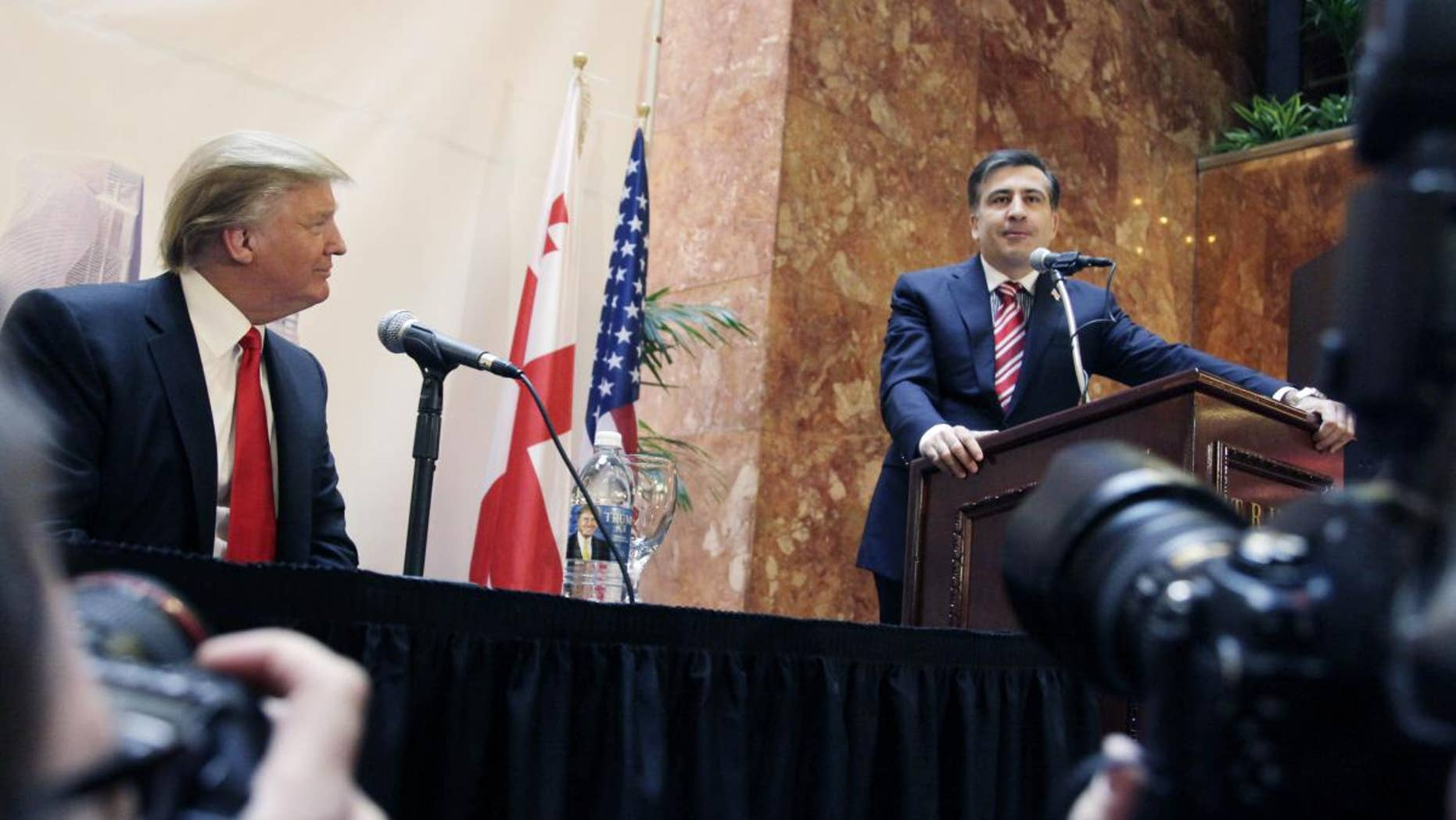 Real estate developer Donald Trump, left, listens to Mikhail Saakashvili, President of Georgia, at a news conference in New York, Thursday, March 10, 2011. Trump and a Georgian development group have agreed to build a Trump Tower in Georgia. Trump indicated he is seriously considering a run for the U.S. presidency. (AP Photo/Mark Lennihan)