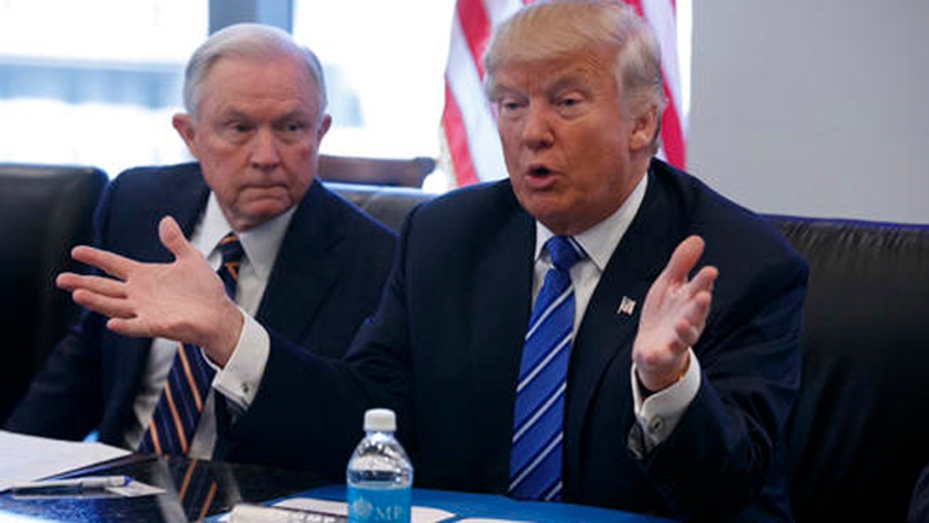 FILE - In this Oct. 7, 2016 file photo, then Sen. Jeff Sessions, R-Ala. listens at left as then-Republican presidential candidate Donald Trump speaks during a national security meeting with advisers at Trump Tower in New York.
