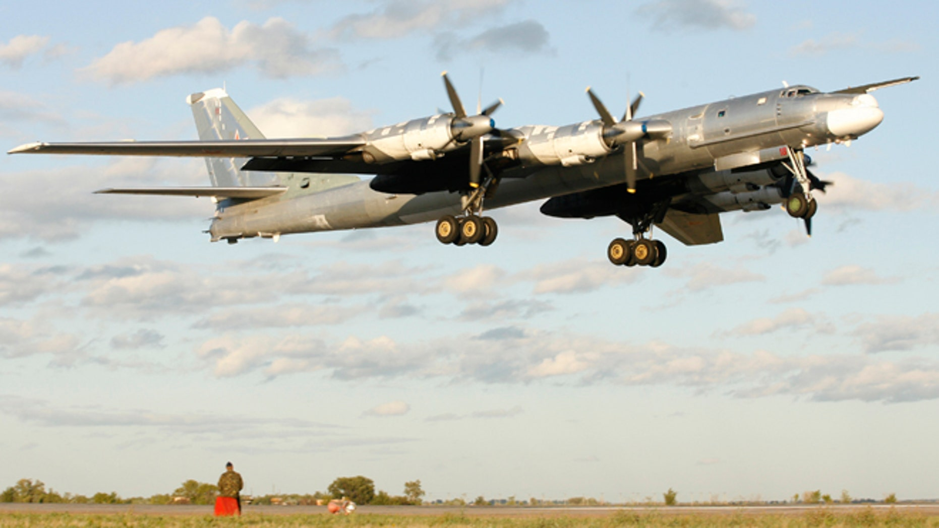 In this August 7, 2008 photo, a Russian TU-95 bomber, or Bear, lands at a military airbase in Engels, some 559 miles south of Moscow.