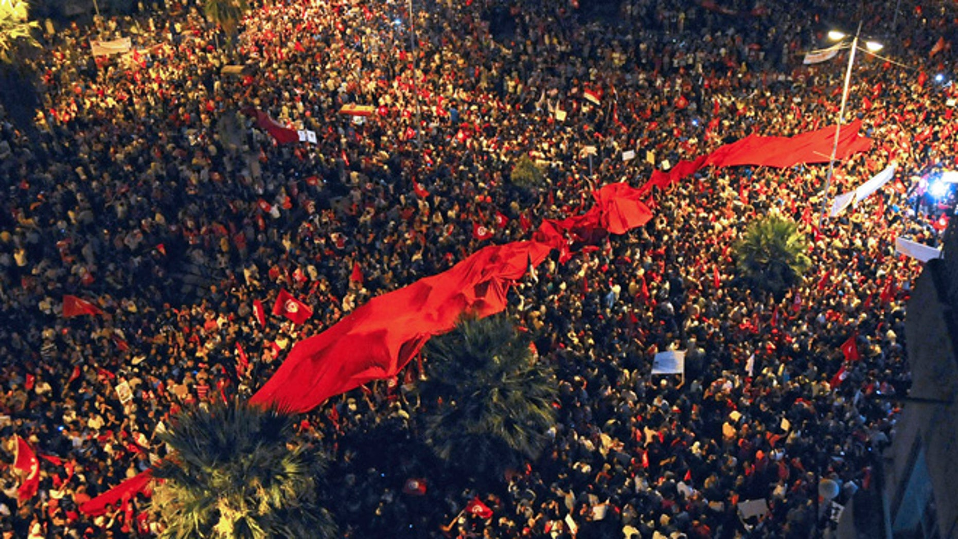 Aug. 6, 2013: People demonstrate against Tunisia's Islamist-led government in Tunis.