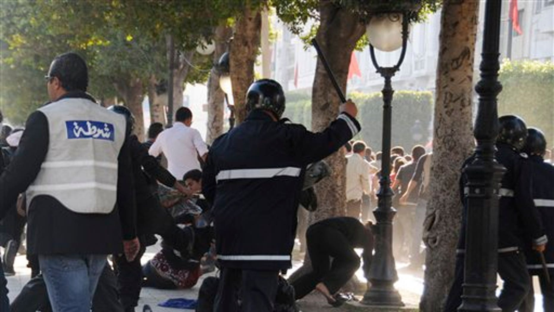 May 5: Tunisian police officers disperse hundreds of demonstrators during clashes in Tunis. The protesters complained Tunisia's new caretaker government has not followed through with the people's revolutionary aspirations. (AP)