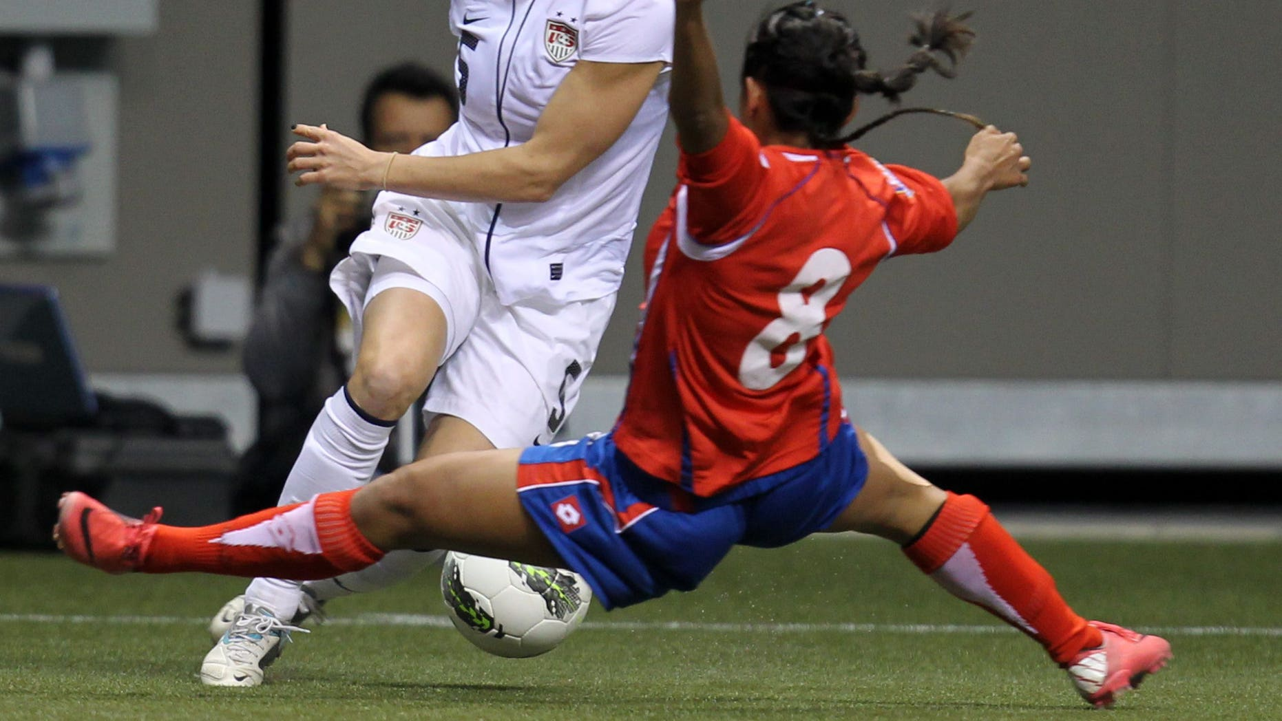 Jan 27, 2012: In this file photo, United States' Kelly O'Hara (5) fights for control of the ball with Costa Rica's Daniela Cruz (8) during the first half of CONCACAF women's Olympic qualifying soccer game action at B.C. Place in Vancouver, British Columbia.