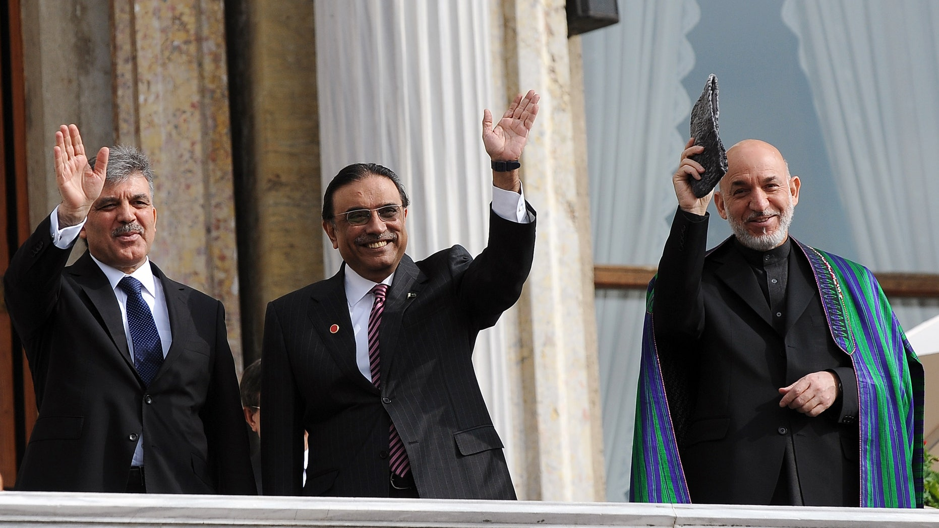 Nov. 1, 2011: Turkish President Abdullah Gul, left, his Afghan counterpart Hamid Karzai, right, and President Asif Ali Zardari of Palistan wave from the balcony of Ottoman-era Ciragan Palace after a meeting in Istanbul, Turkey.