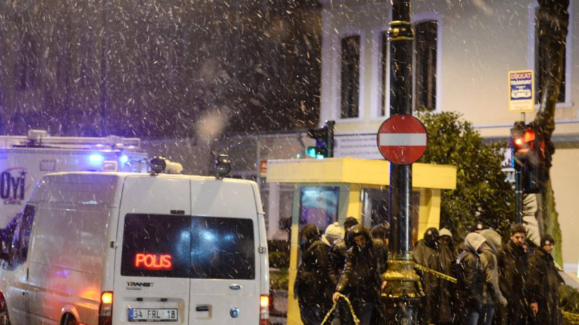 Turkish security members are seen outside the police station, after a policeman was killed and another injured when a female suicide bomber blew herself up in Istanbul, Turkey, Tuesday, Jan. 6, 2015. Istanbul governor Vasip Sahin said the woman entered a police station and reported a missing wallet before detonating a bomb. The attack occurred in the Sultan Ahmet district, a popular tourist destination.(AP Photo)