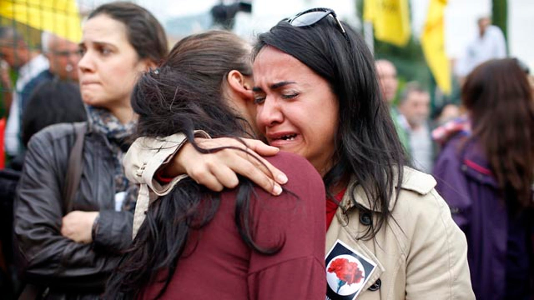 Oct. 12, 2015: Mourners cry during the funeral of Uygar Coskun, 32, killed in Saturday's bombing attacks, during his funeral, in Ankara, Turkey. (AP Photo/Emrah Gurel)