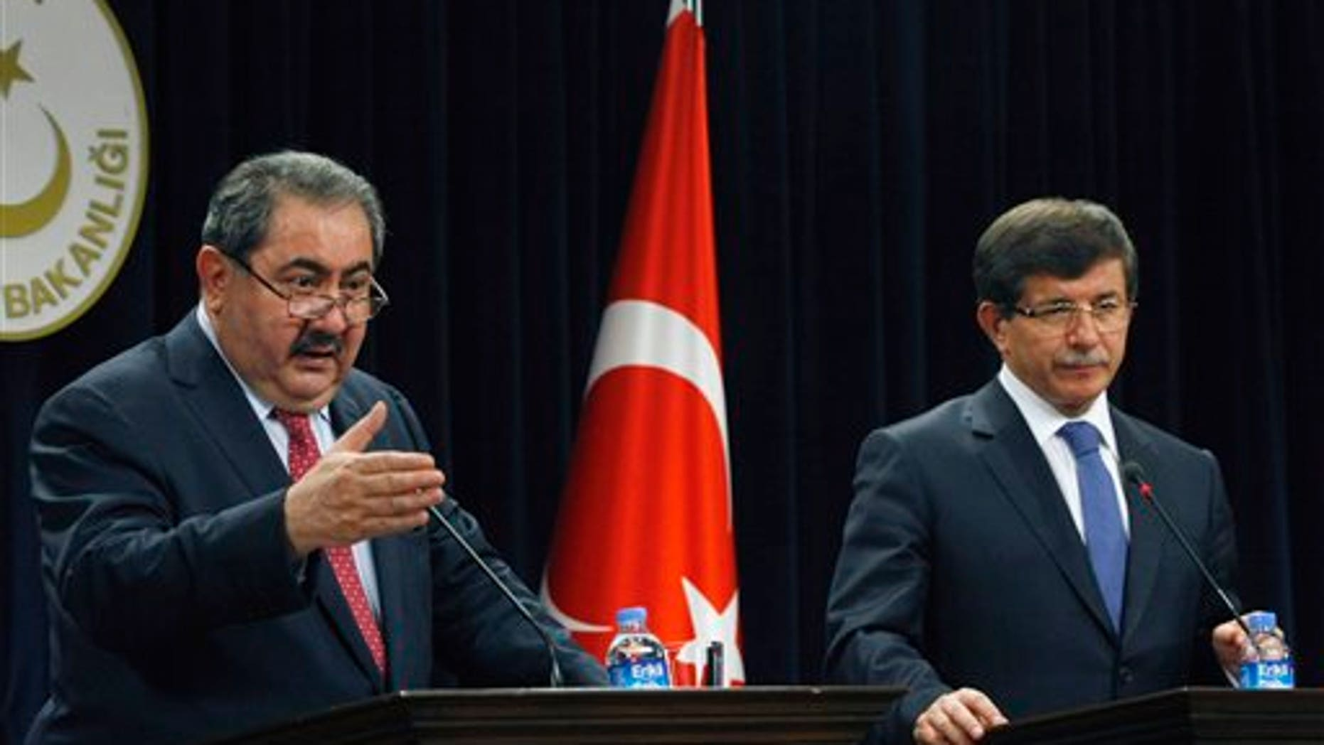 October 13: Iraqi Foreign Minister Hoshyar Zebari, left, and his Turkish counterpart Ahmet Davutoglu speak to the media after their talks in Ankara, Turkey.