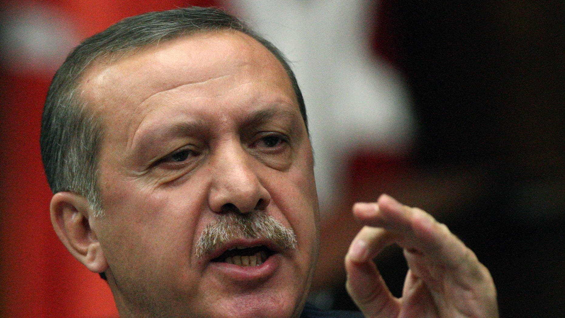 FILE: Turkish Prime Minister Recep Tayyip Erdogan addresses his lawmakers at the parliament in Ankara, Turkey.