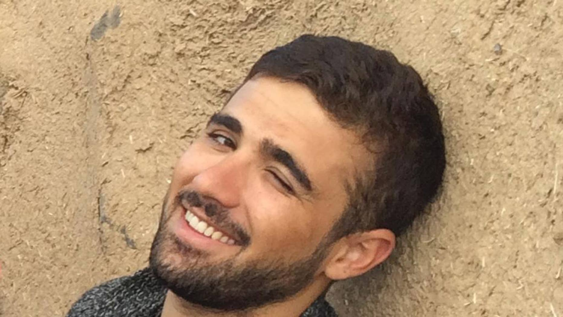 In this Saturday Nov. 1, 2014 photograph, freelance translator Mohammed Rasool is pictured during a break while working with an Associated Press team in Turkey. In August 2015, Rasool, a 24-year-old Iraqi Kurd who has worked as a fixer for The Associated Press, was helping two Vice News reporters covering clashes between the PKK's youth group and police. He was arrested on Aug. 27 and remains in a maximum security prison and Turkish authorities have neither indicted him nor adequately explained why they are holding him. (AP Photo/Elena Becatoros)