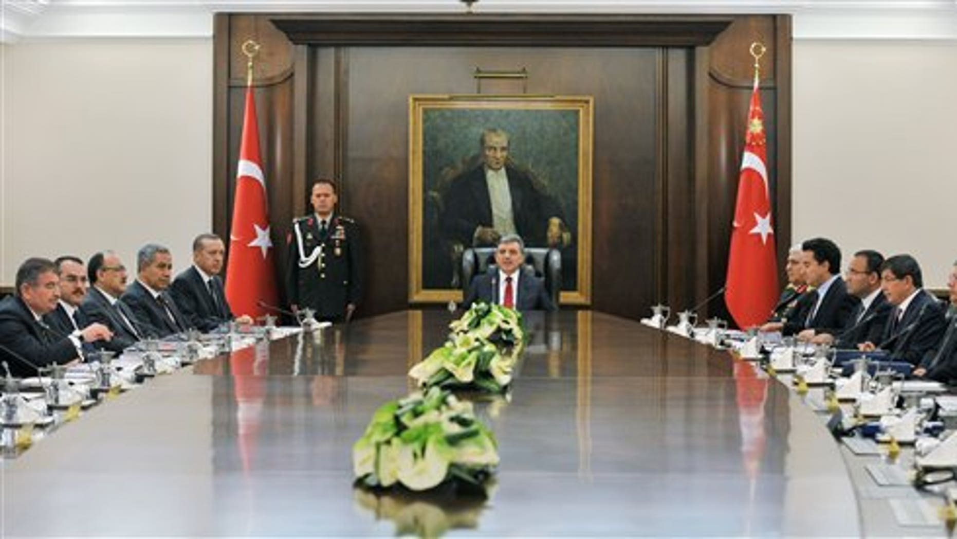 August 18: President Abdullah Gul, center, chairs a National Security Council meeting with Prime Minister Recep Tayyip Erdogan, 5th from left, ministers and top military commanders, two days after Kurdish rebels killed 8 Turkish soldiers at the Turkey-Iraq border, at the Presidential Palace in Ankara, Turkey.