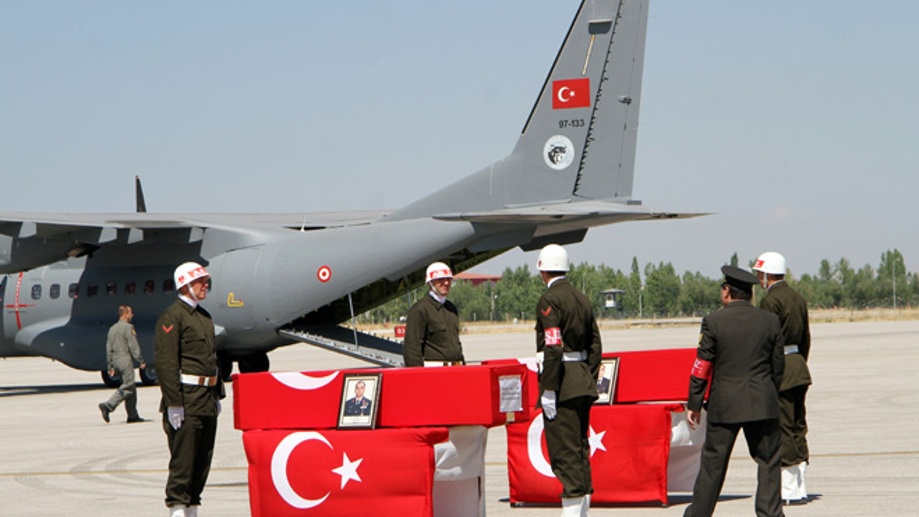 Sept. 8, 2015: Turkish soldiers prepare the coffins of fallen comrades before a ceremony at the military airport in Van, Turkey.
