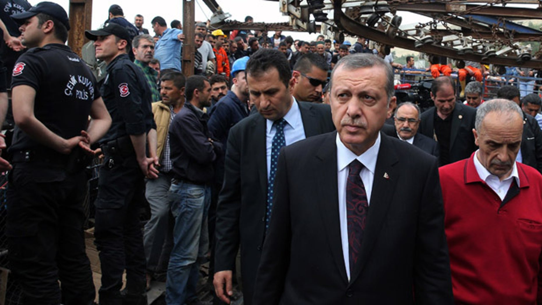 May 14, 2014: In this photo released by the Turkish Prime Minister's Press Office, Turkish Prime Minister Recep Tayyip Erdogan is surrounded by security members as he visits the coal mine in Soma, Turkey (AP Photo/Kayhan Ozer, Turkish Prime Minister's Press Office, HO)
