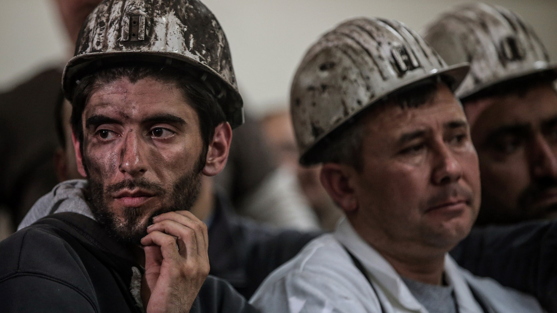 May 16, 2014 - Turkish miners listen to the mining company's owner, Alp Gurkan, during a news conference in Soma, Turkey. The Turkish mining company defended its safety record, 4 days after more than 284 people died in an underground blaze at its coal mine in western Turkey.