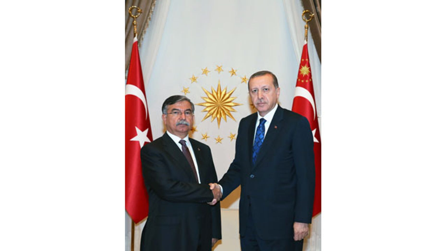 Aug. 24, 2015: Turkey's President Recep Tayyip Erdogan, right, shakes hands with Parliament Speaker Ismet Yilmaz in Ankara. (AP Photo/Presidential Press Service, Pool)
