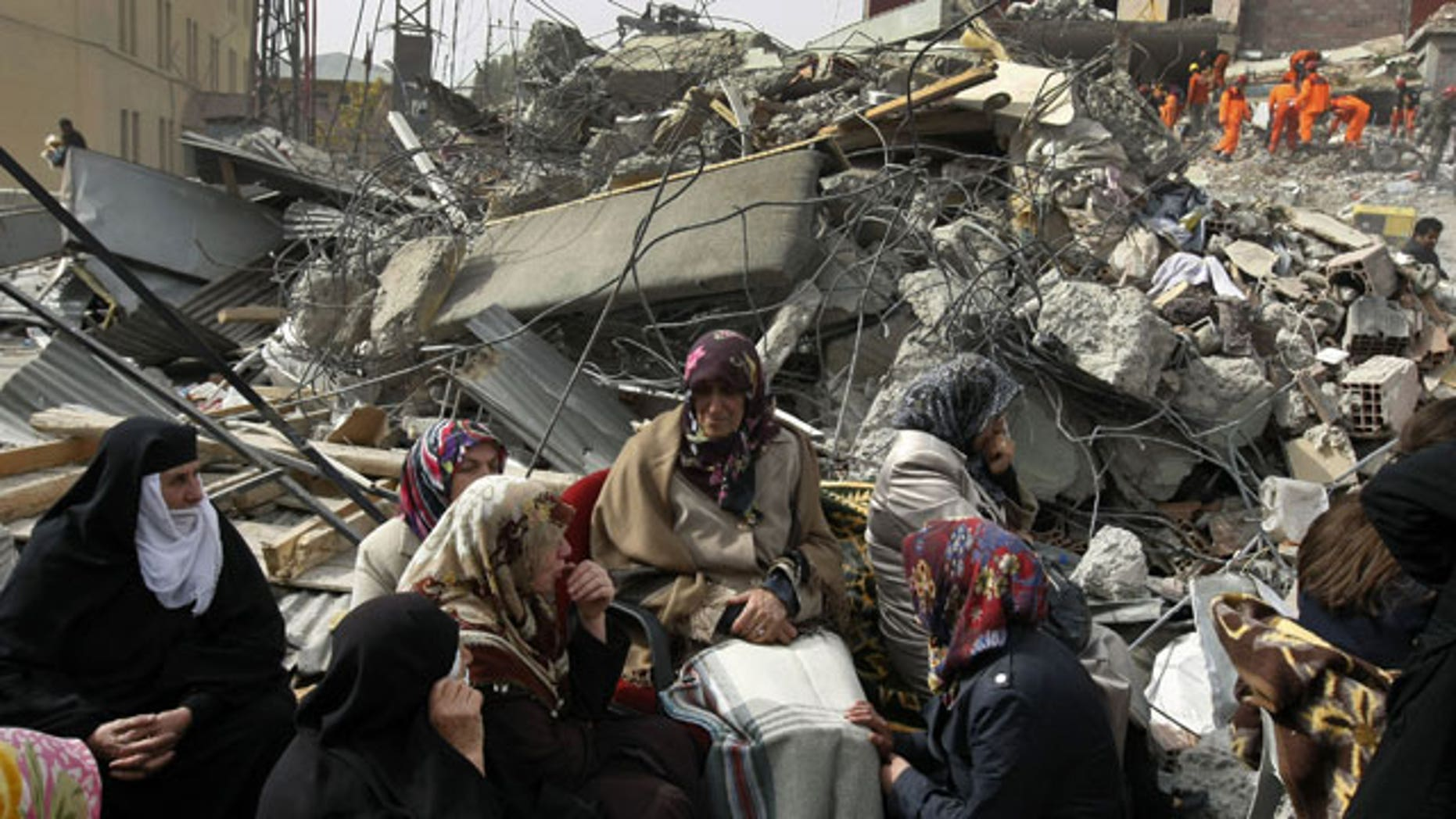 October 25, 2011: Family members wait for news as Turkish and Azeri rescuers work to save people trapped under the rubble of a collapsed building in Ercis, eastern Turkey.