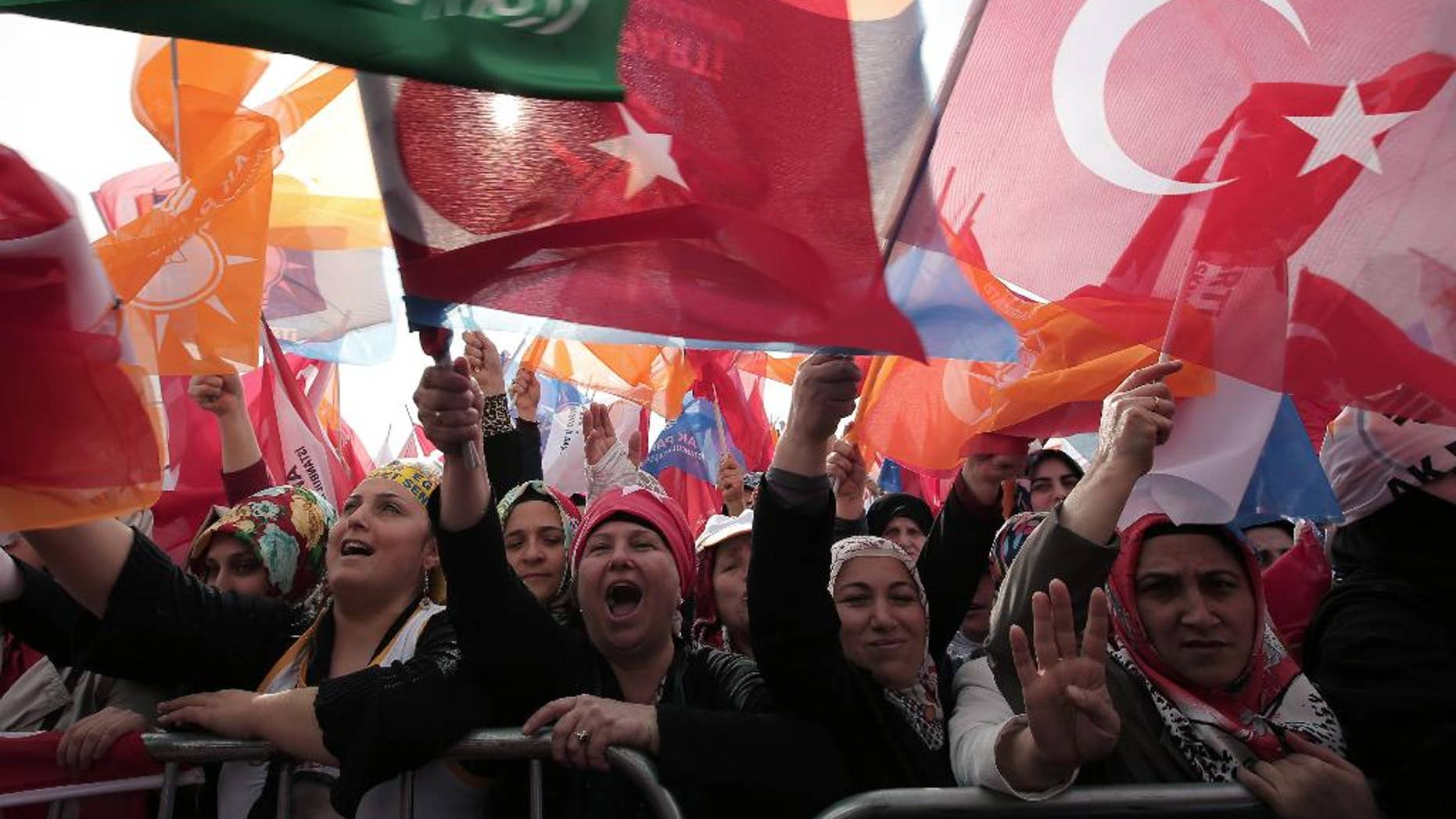 The supporters listen to Turkish Prime Minister Recep Tayyip Erdogan who addressed a rally of his Justice and Development Party in Istanbul, Turkey, Sunday, March 23, 2014. Turkish fighter jets shot down a Syrian warplane after it violated Turkey's airspace Sunday, Erdogan said, in a move likely to ramp up tensions between the two countries already deeply at odds over Syria's civil war. Erdogan is fighting corruption allegations against his government a week before local elections that are seen as a referendum over his rule. (AP Photo/Emrah Gurel)
