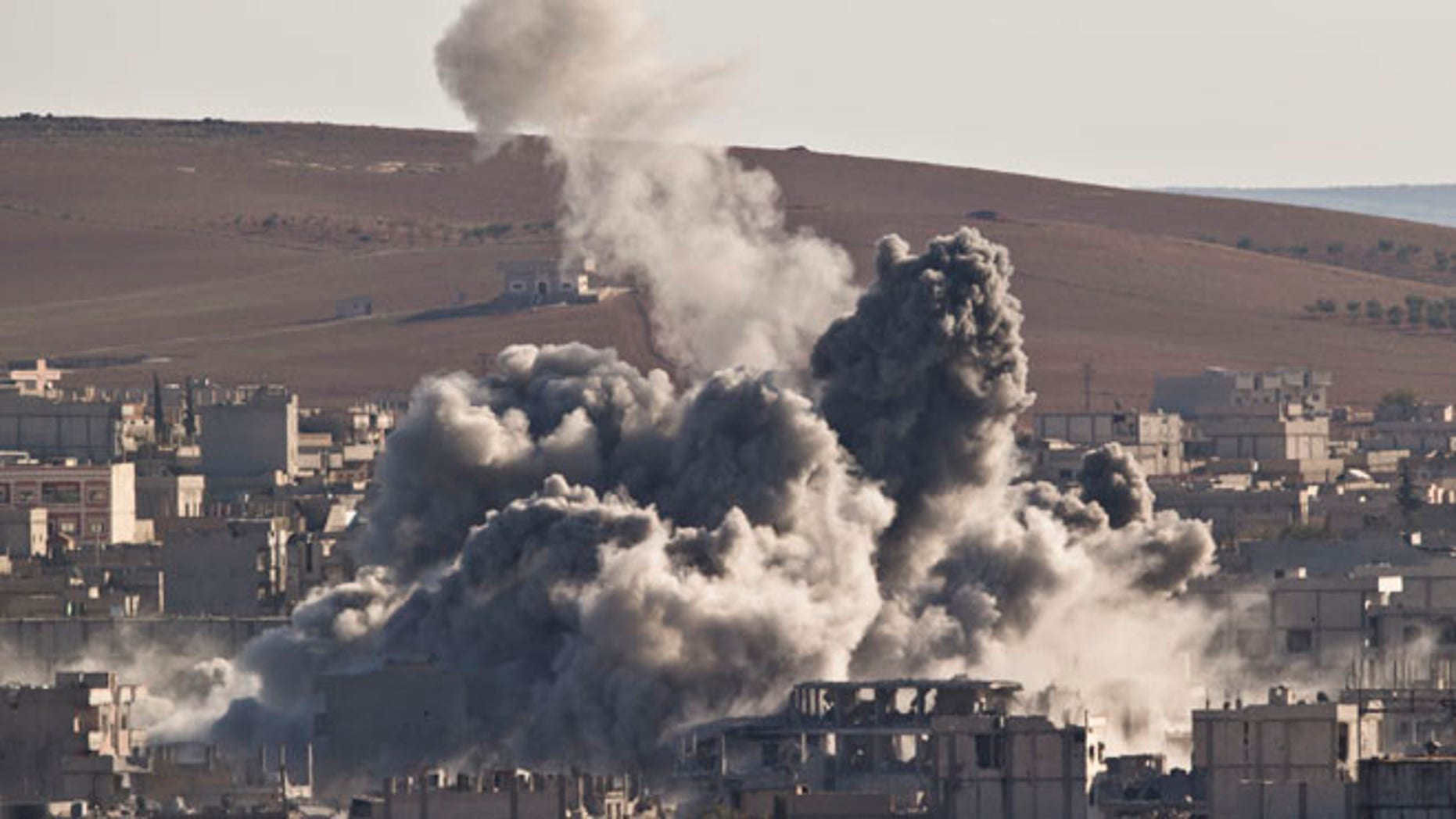 Nov. 9, 2014: Smoke rises in the Syrian town of Kobani, after an airstrike by the US led coalition, seen from a hilltop outside Suruc, on the Turkey-Syria border. (AP)