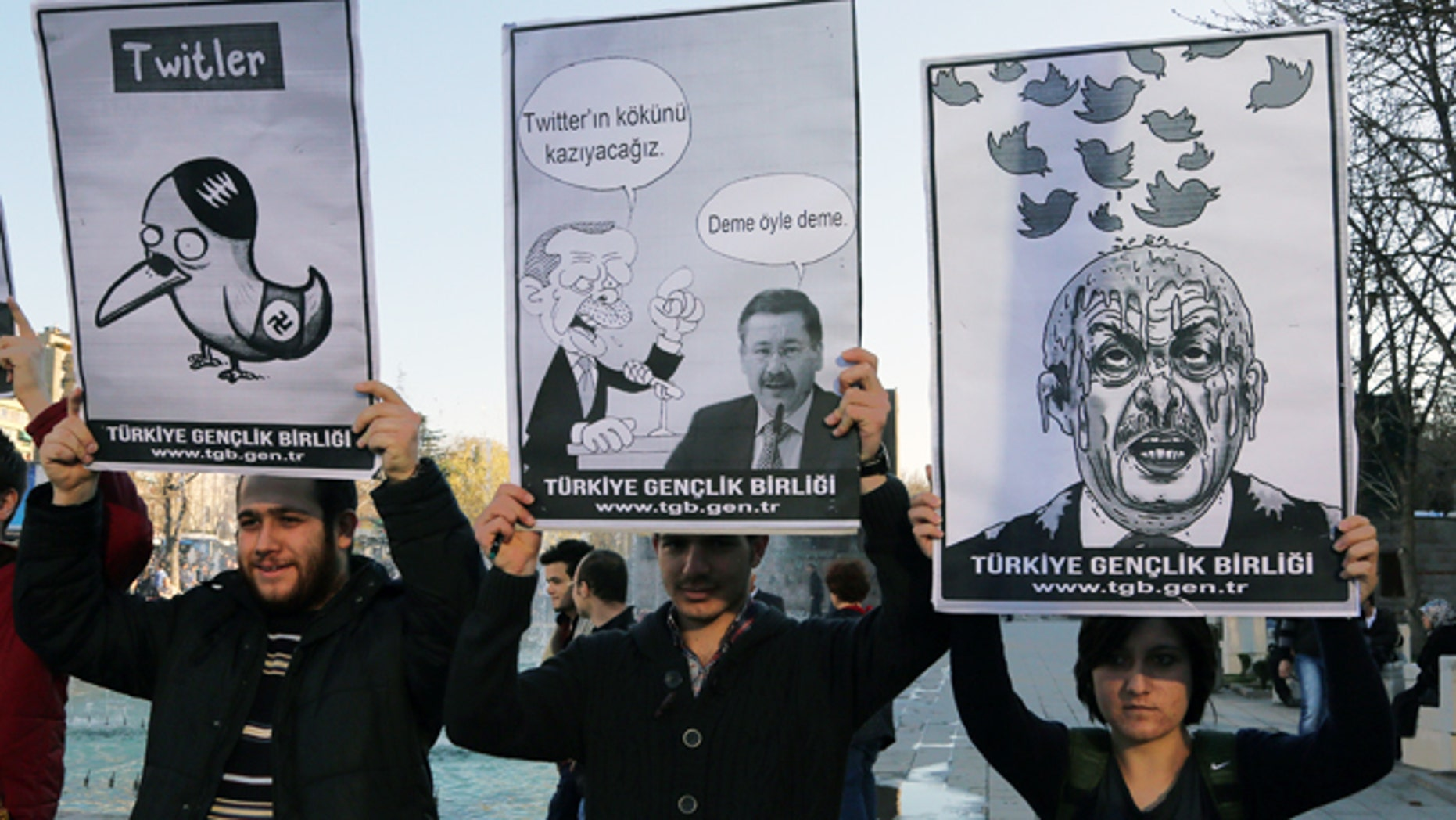 March 21, 2014: Members of the Turkish Youth Union hold cartoons depicting Turkey's Prime Minister Recep Tayyip Erdogan during a protest against a ban on Twitter, in Ankara, Turkey.