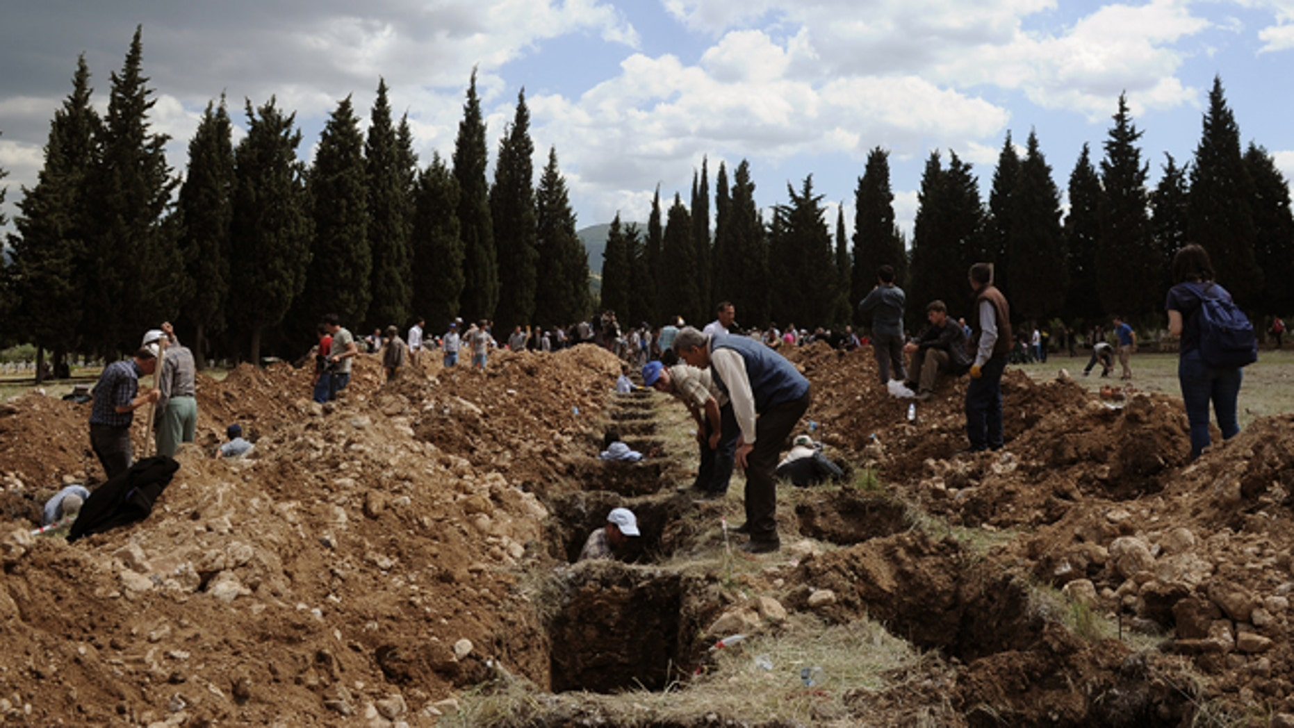 May 15, 2014: People prepare graves for the mine accident victims in Soma, Turkey. (AP)
