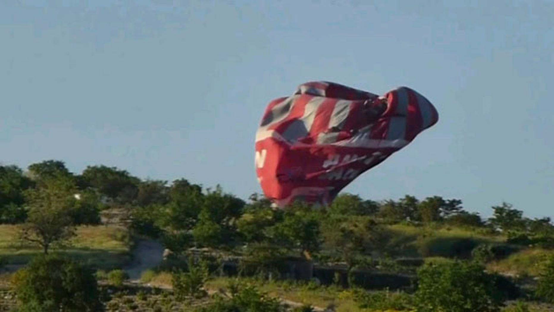 May 20 2013: This image from video provided by E. Wayne Ross shows an Anatolian Balloons Company hot air balloon crashing near Göreme National Park and the Rock Sites of Cappadocia in central Turkey.