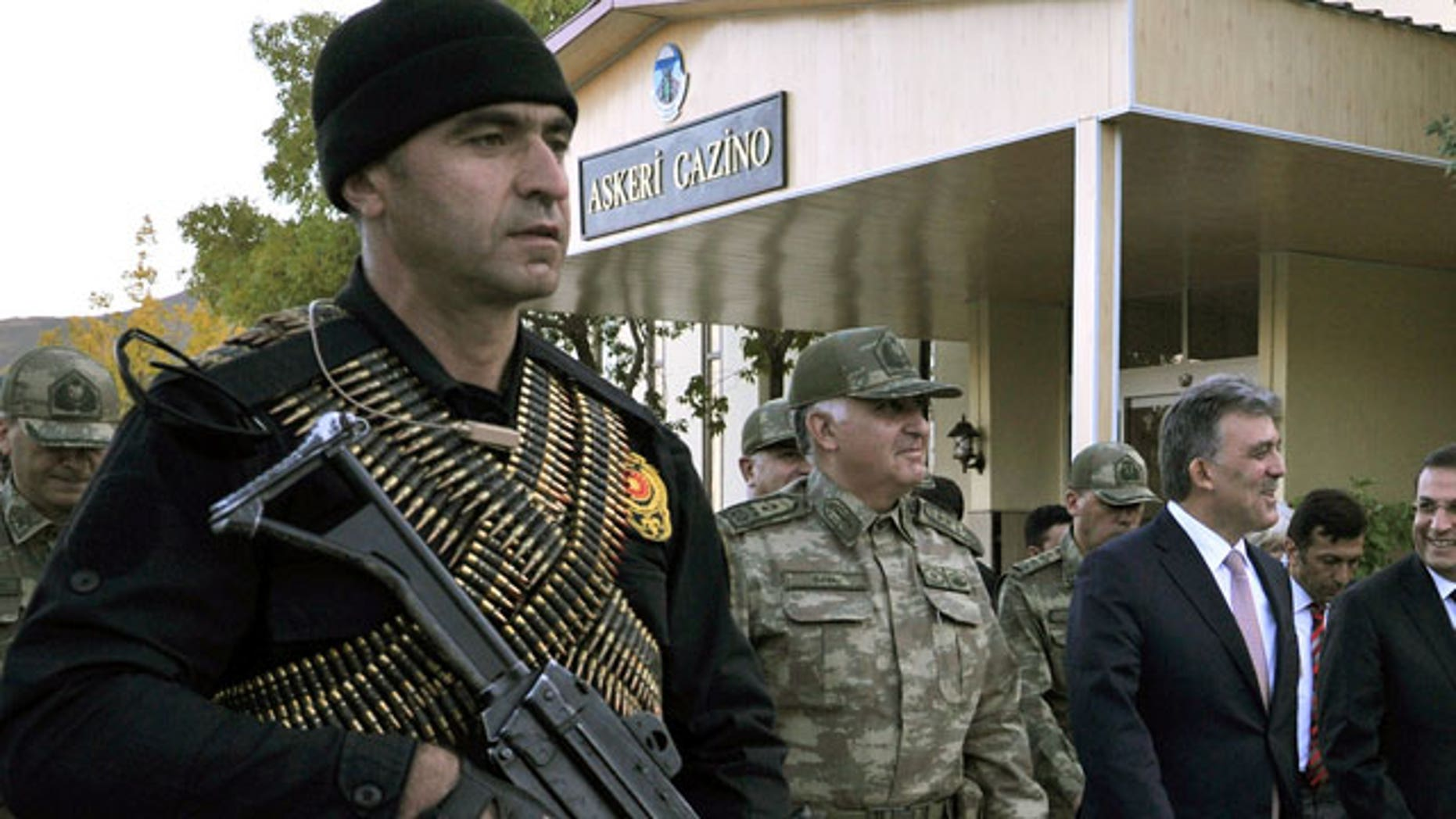 Oct. 14, 2011: Turkish President Abdullah Gul, right, and Chief of Staff Gen. Necdet Ozel, center, walk in Hakkari, Turkey as they visit Turkish troops at the border with Iraq.