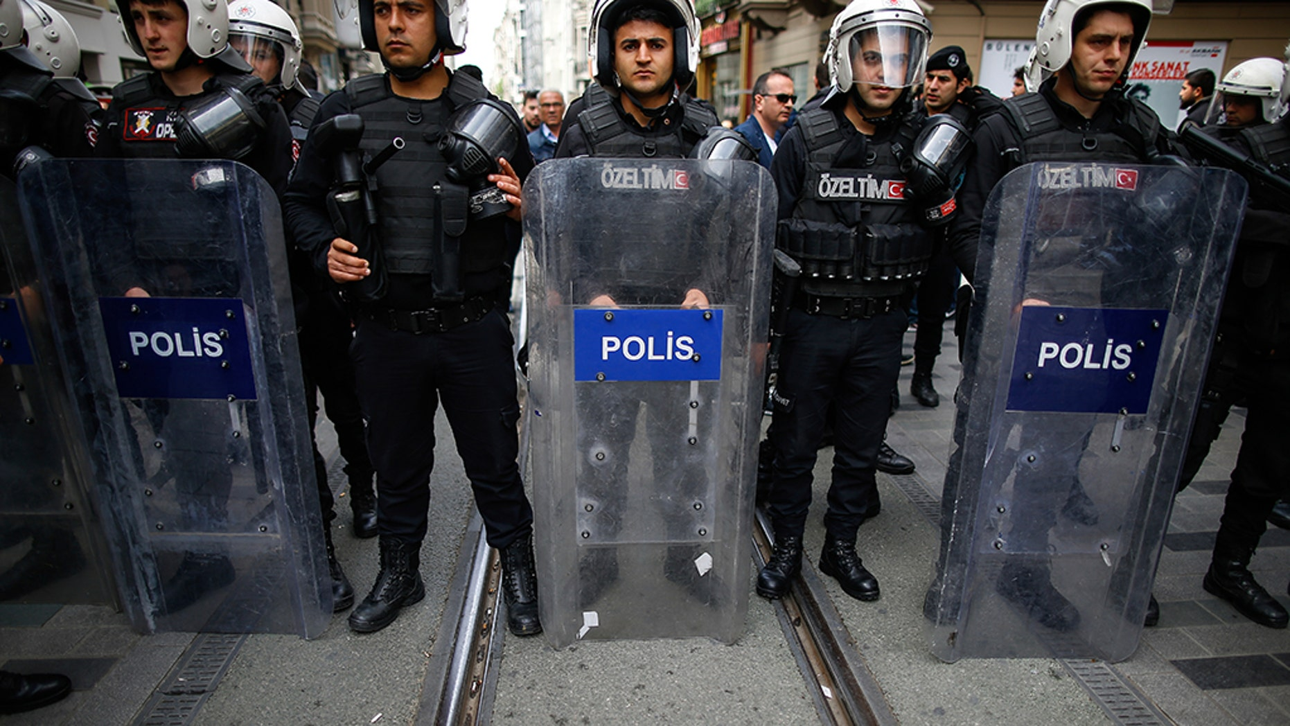 Turkey's police officers looking on as supporters of Turkey's main opposition Republican People's Party, CHP, gather to protest near central Istanbul's Taksim Square.